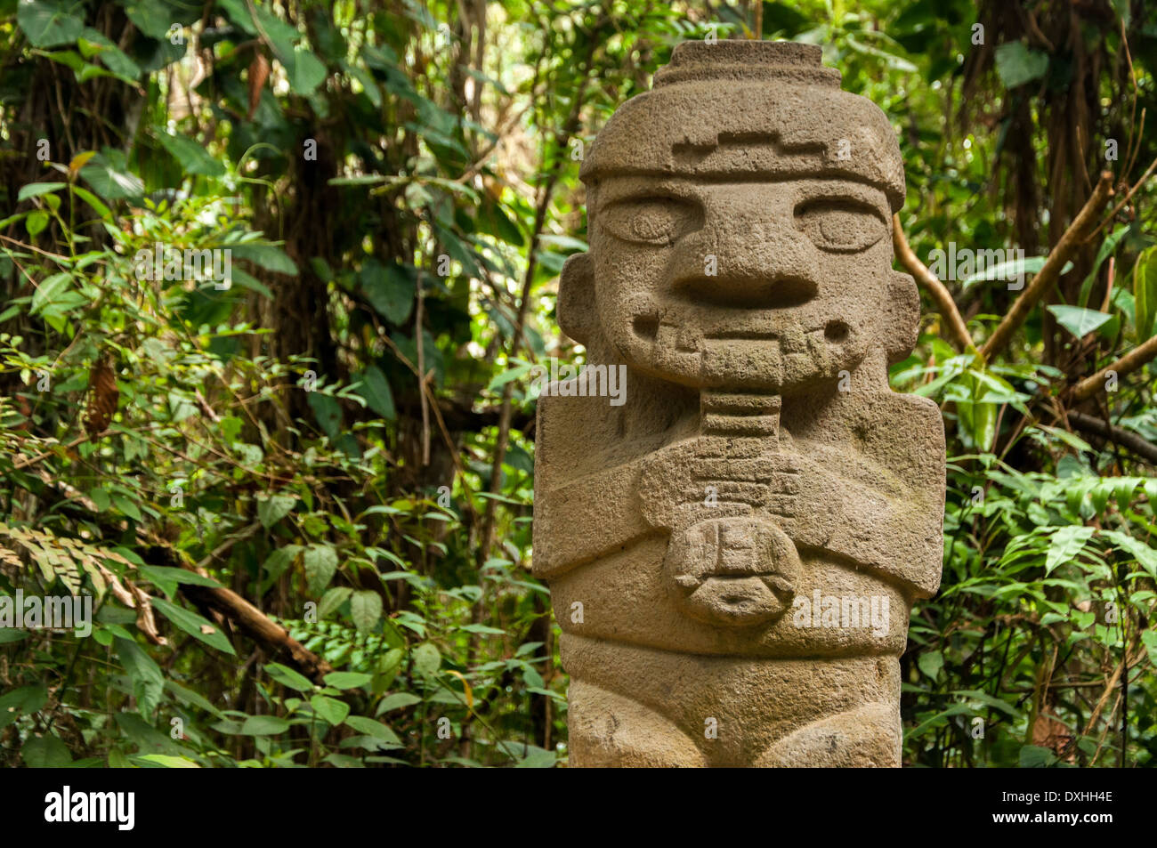 An ancient, flute playing, pre-columbian statue in San Agustin, Colombia - Stock Image