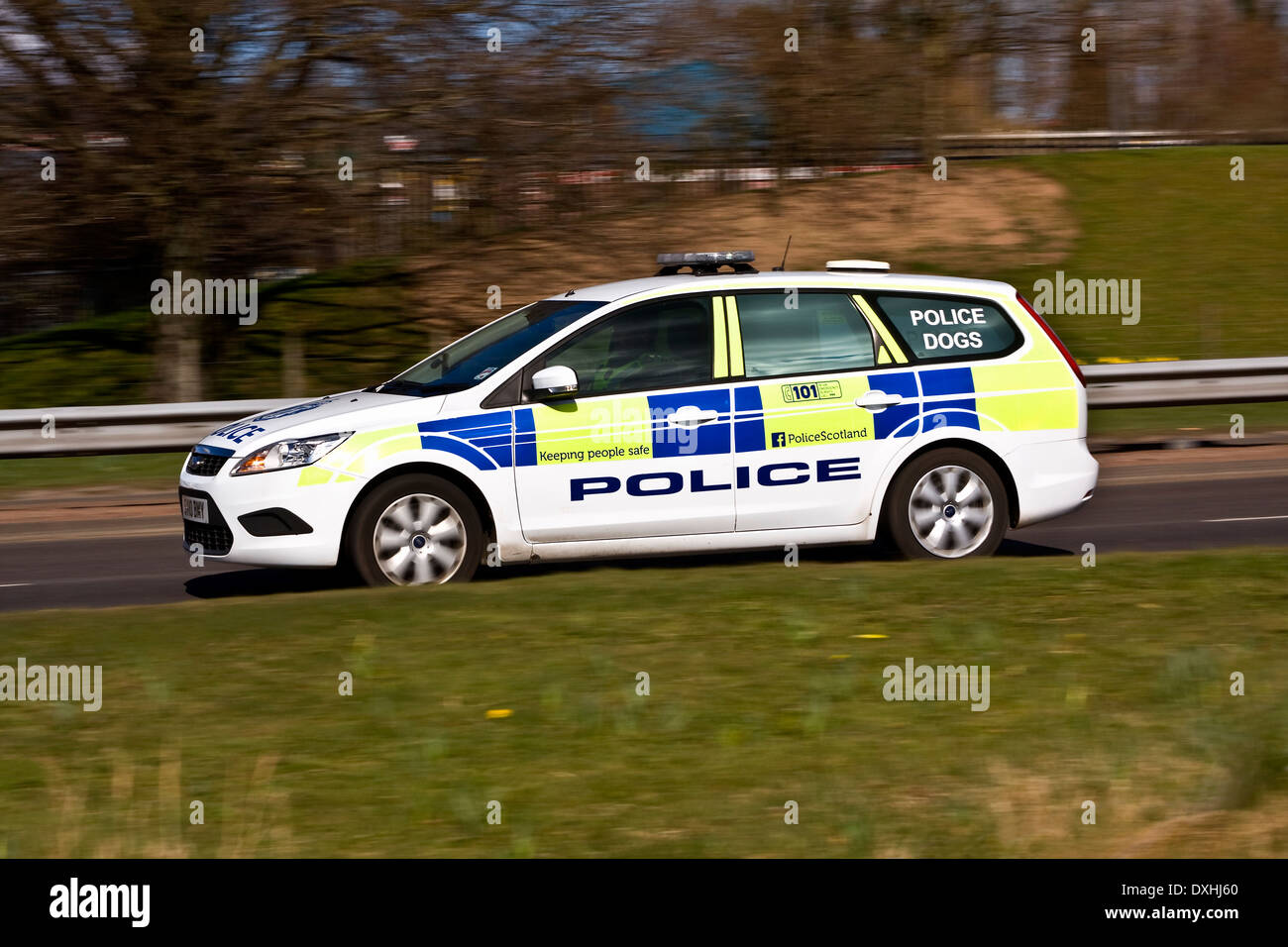 "Panning a ""Police Scotland"" Police Car without rear sync flash speeding along the Kingsway West Dual Carriageway Stock Photo"