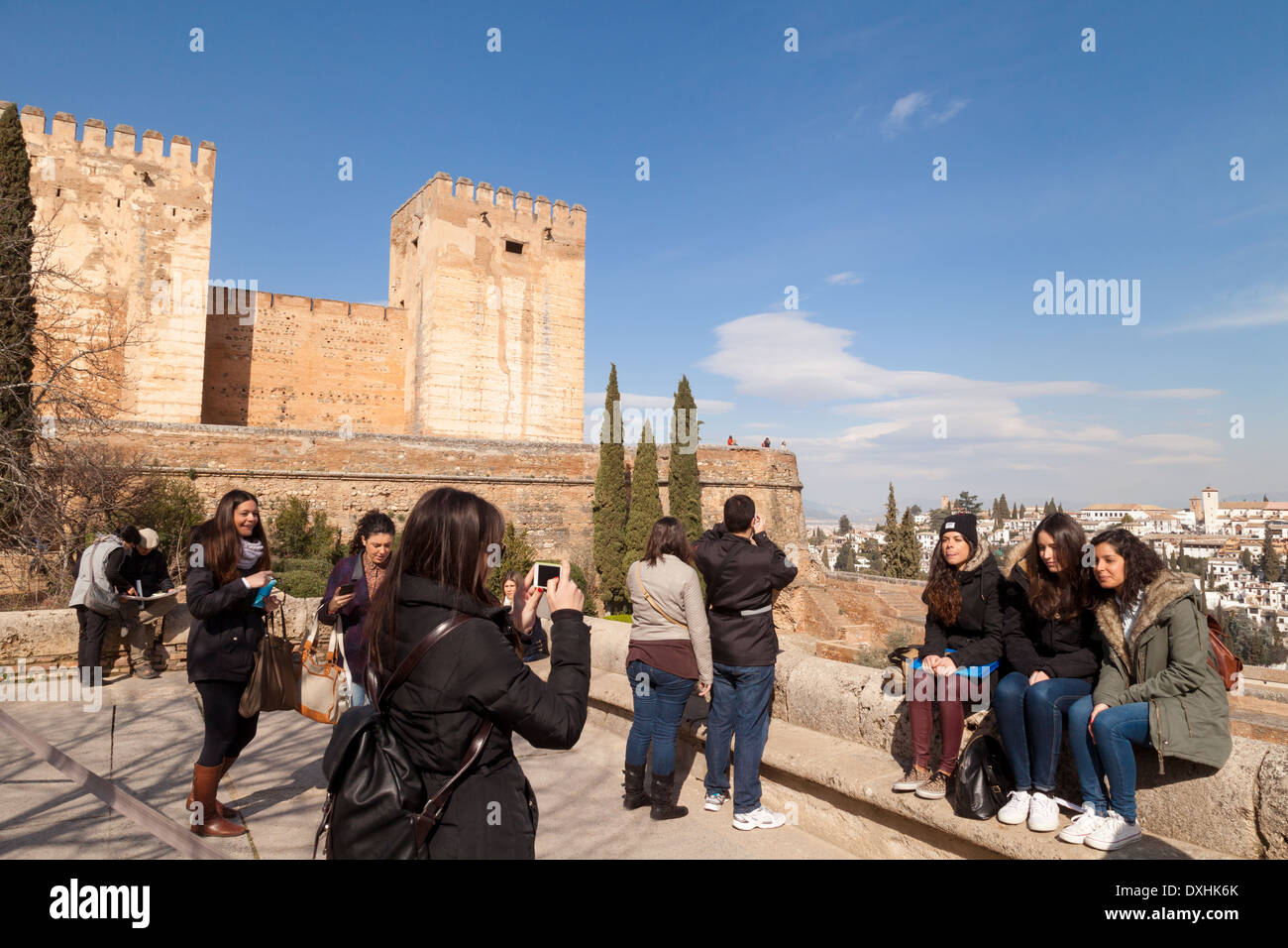 Visitors taking photos at the Alcazaba, part of the Alhambra Palace, Granada, Andalusia Spain Europe - Stock Image