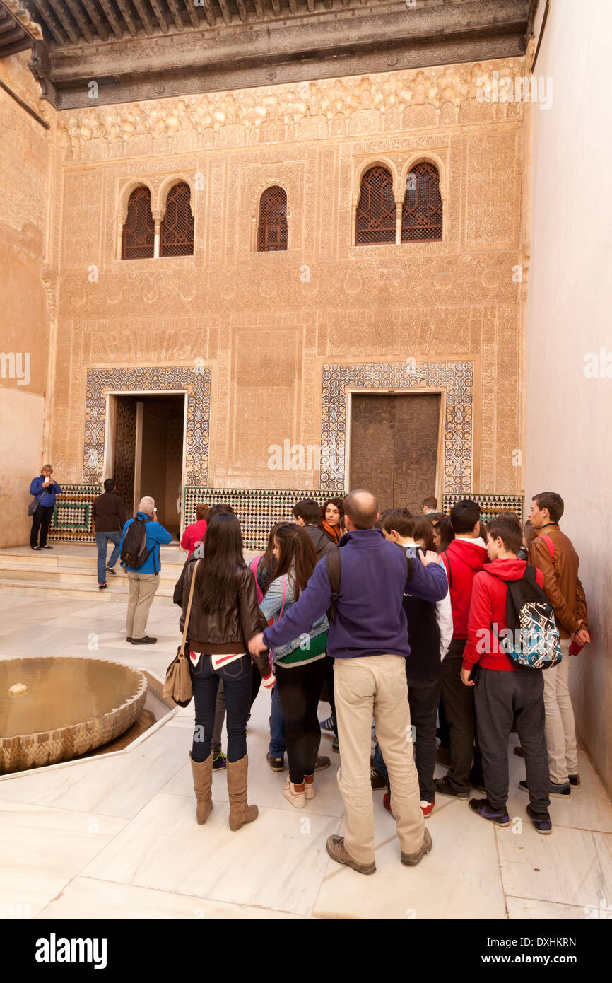 Teens on a school trip to the Nasrid Palaces, Alhambra Palace, Granada Andalusia Spain Europe - Stock Image