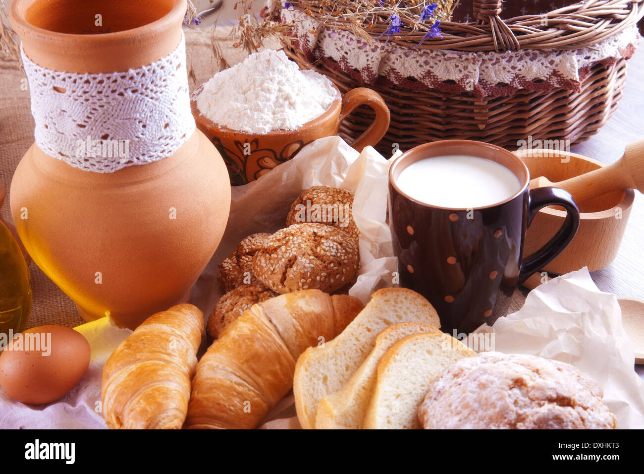 Still life with milk and fresh homemade cakes - Stock Image