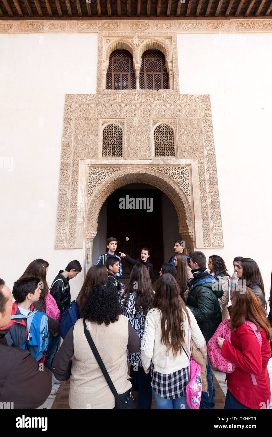 Teenagers teens on a school trip tour of the Alhambra Palace, Granada, Andalusia Spain Europe - Stock Image