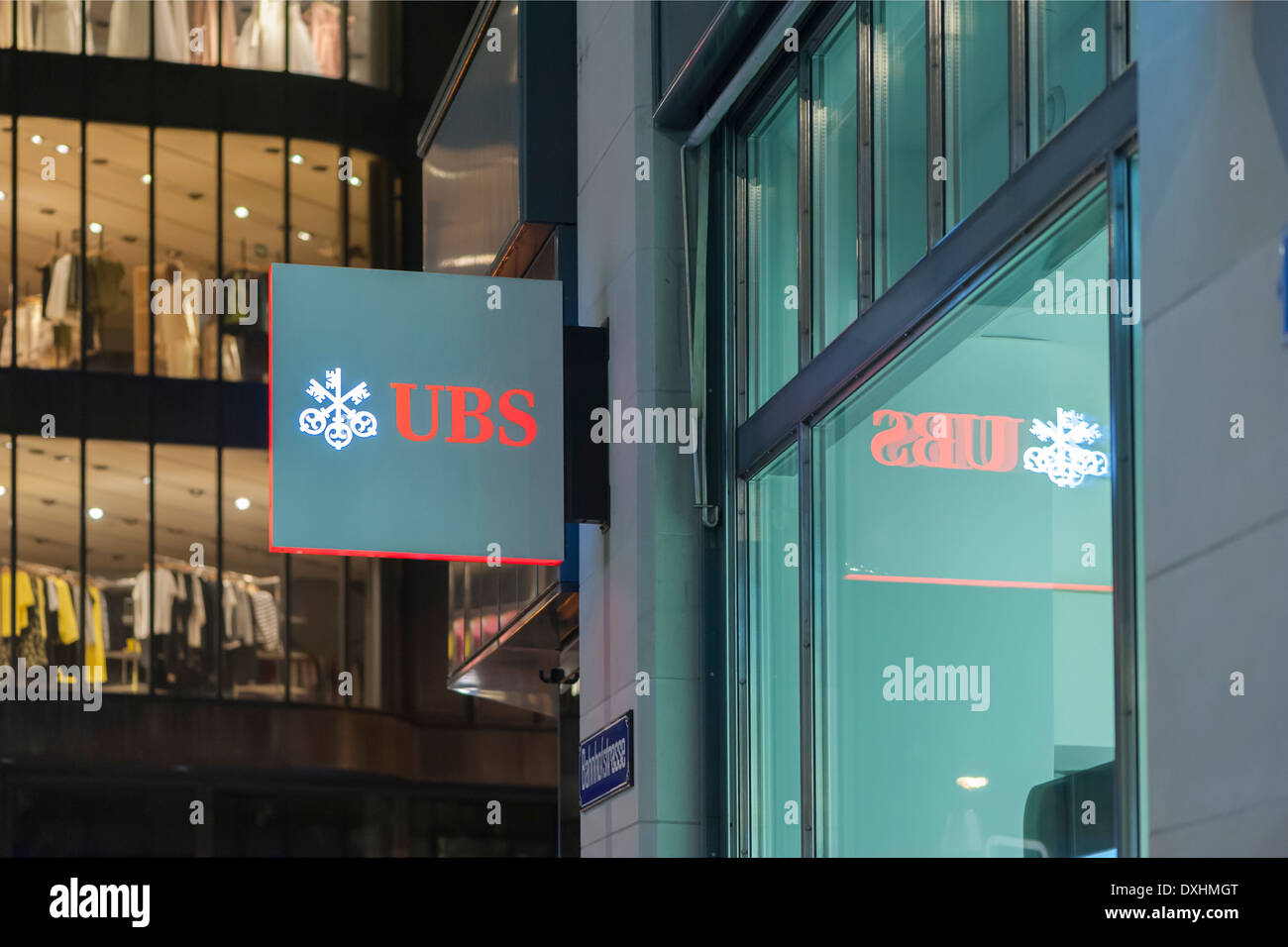 Entrance of a branch of UBS, Switzerland's largest bank on Bahnhofstrasse in Zurich, Switzerland, at night. - Stock Image