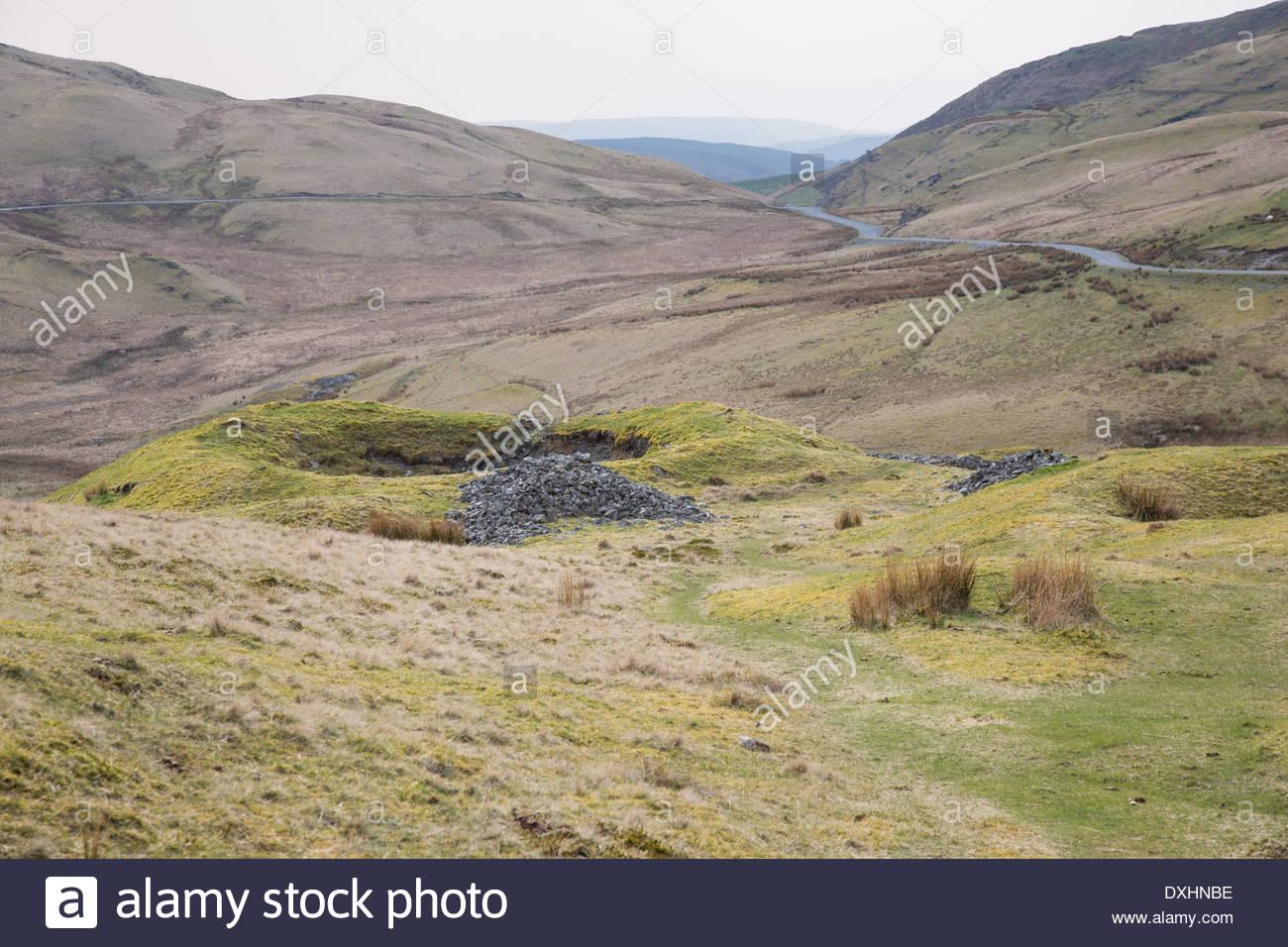 Derelict abandoned silver lead mine workings, shaft, Pumlumon mountain range in mid Wales - Stock Image