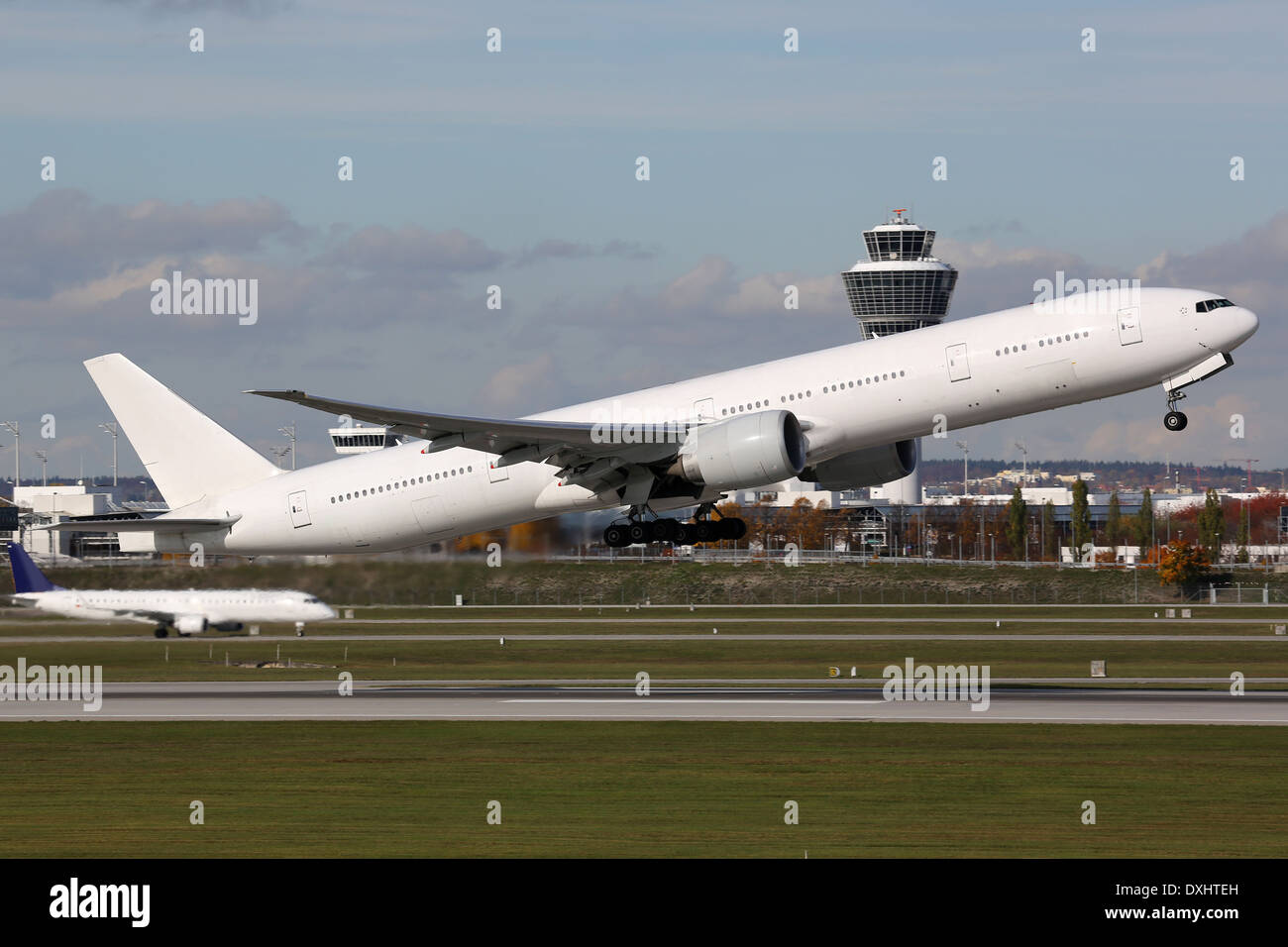 An airplane is taking off at Munich airport Stock Photo