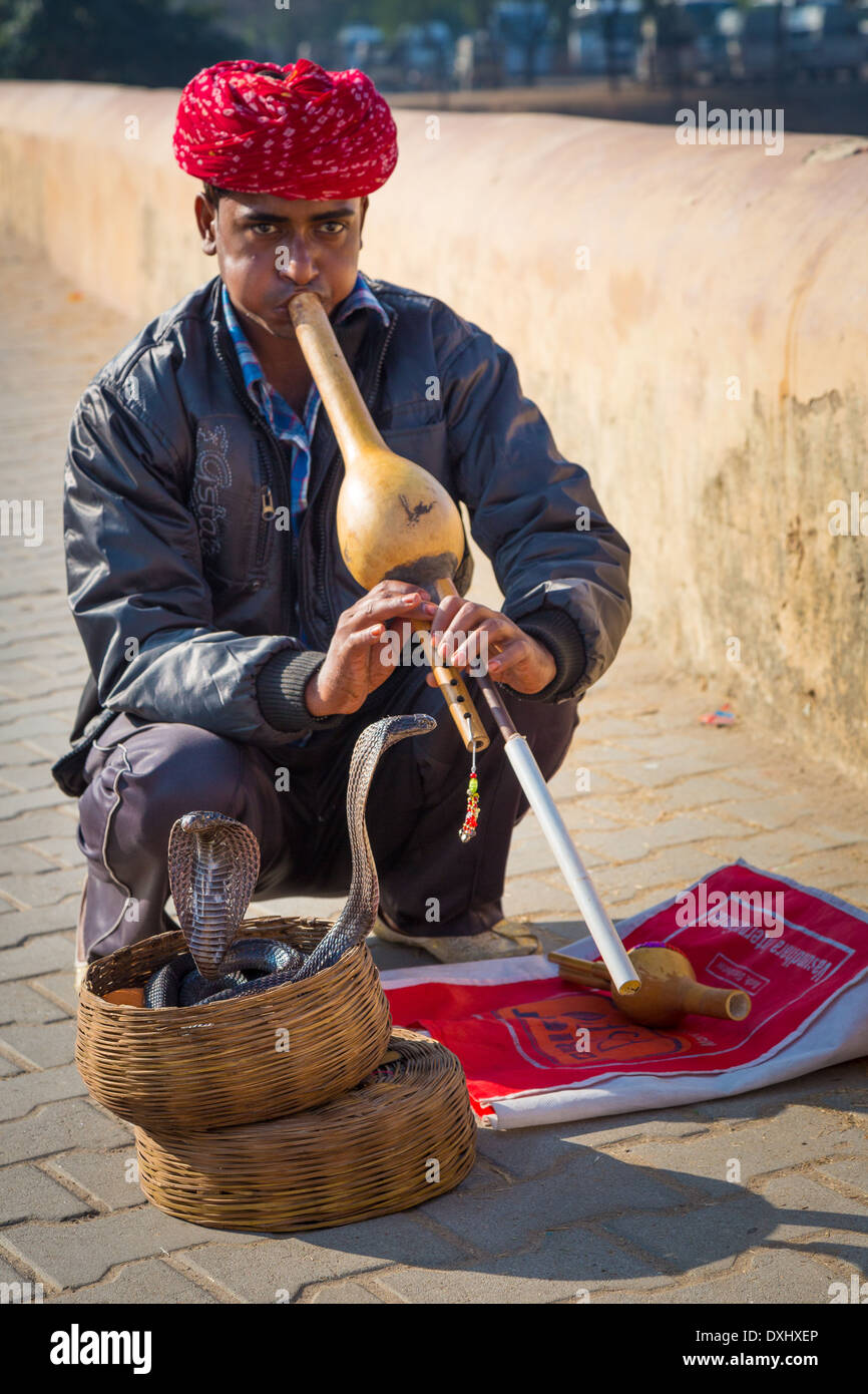 Snake charmer at Amer Fort in Rajasthan, India - Stock Image