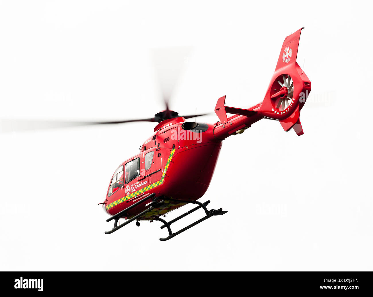 North West Eurocopter EC135 T2 Helicopter G-NWAE Overflying Alsager Cheshire on a Medical Emergency England United Kingdom UK - Stock Image