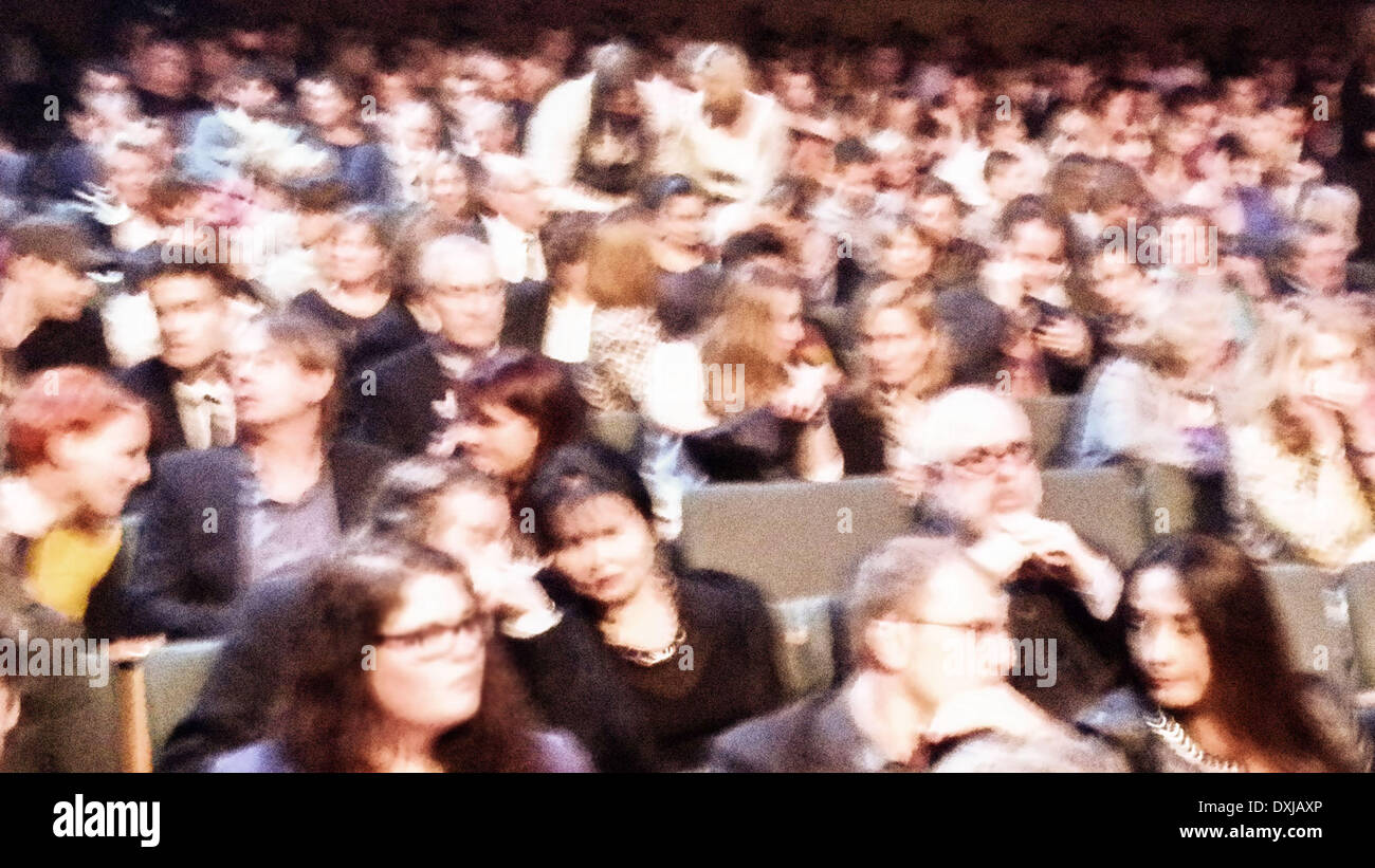 Stylised photograph of an audience before the show begins. - Stock Image