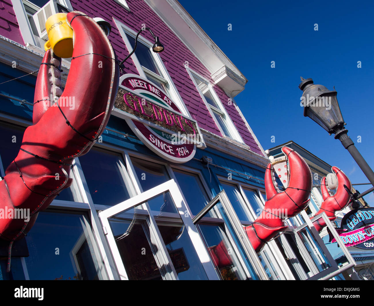 Giant lobster claws outside a seafood restaurant in Bar Harbour, Maine 4 - Stock Image