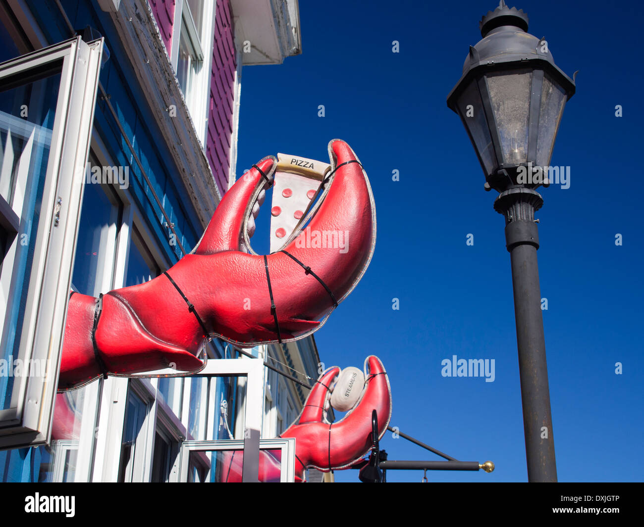 Giant lobster claws outside a seafood restaurant in Bar Harbour, Maine 3 - Stock Image