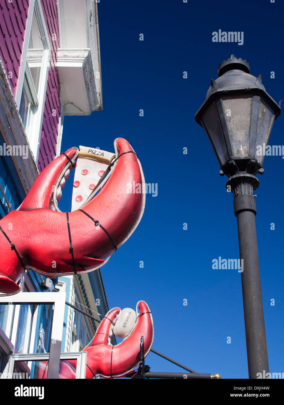 Giant lobster claws outside a seafood restaurant in Bar Harbour, Maine 2 - Stock Image