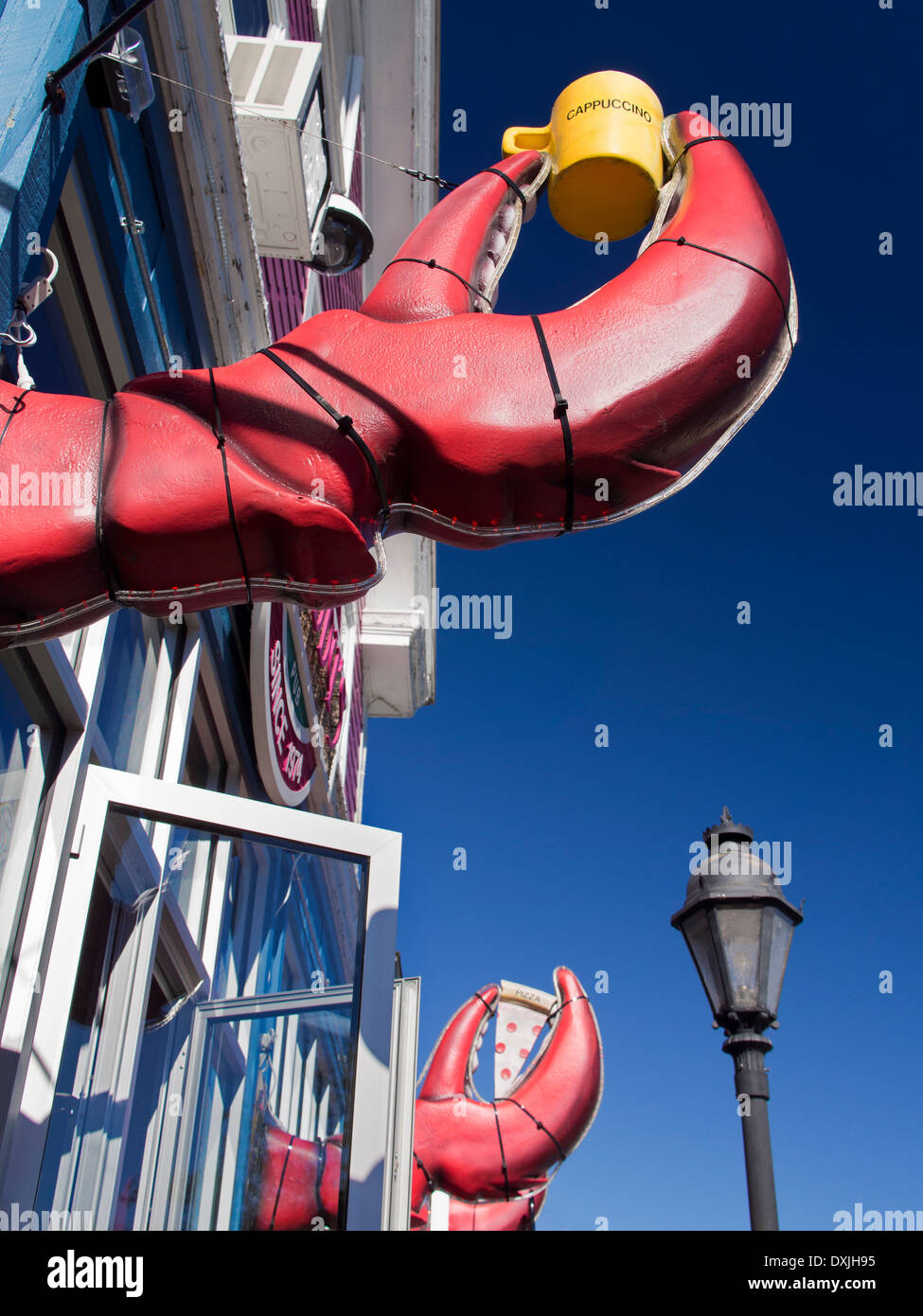 Giant lobster claws outside a seafood restaurant in Bar Harbour, Maine - Stock Image
