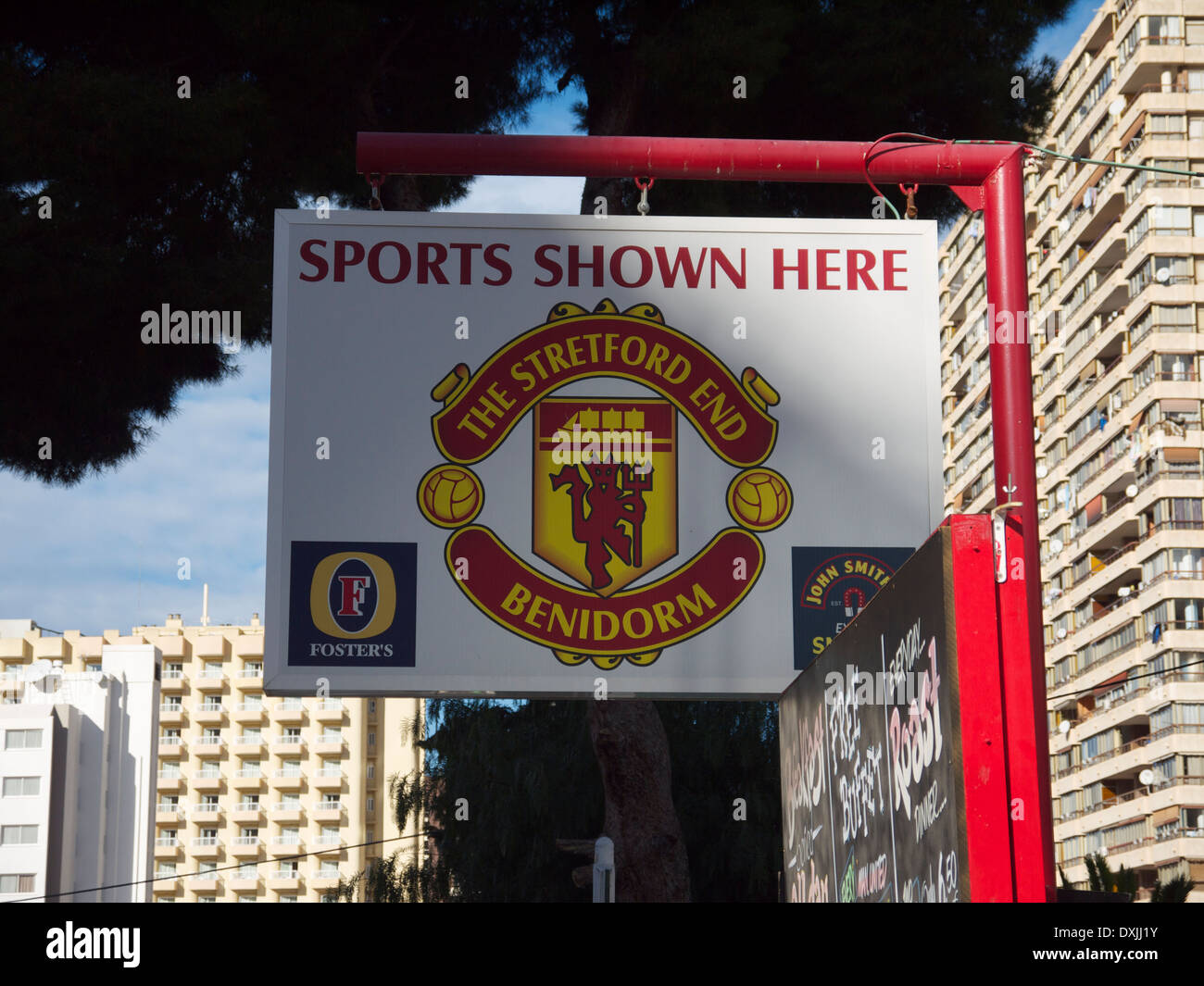 The Stretford End sports bar in Benidorm, Spain using the Manchester United football logo design. - Stock Image