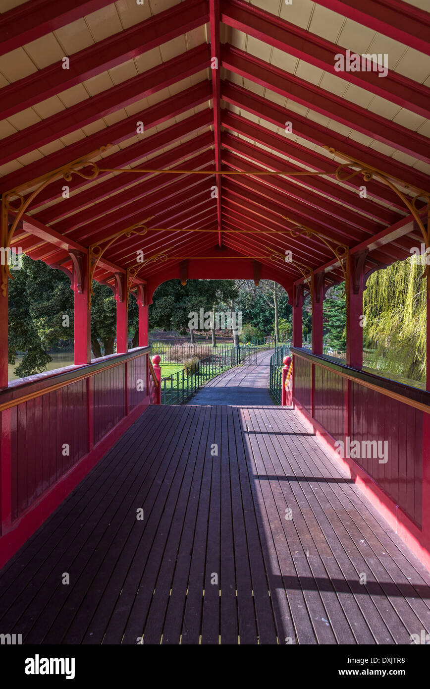 Birkenhead Central park , the model for Central Park in New York, USA. The covered bridge over the lake. - Stock Image