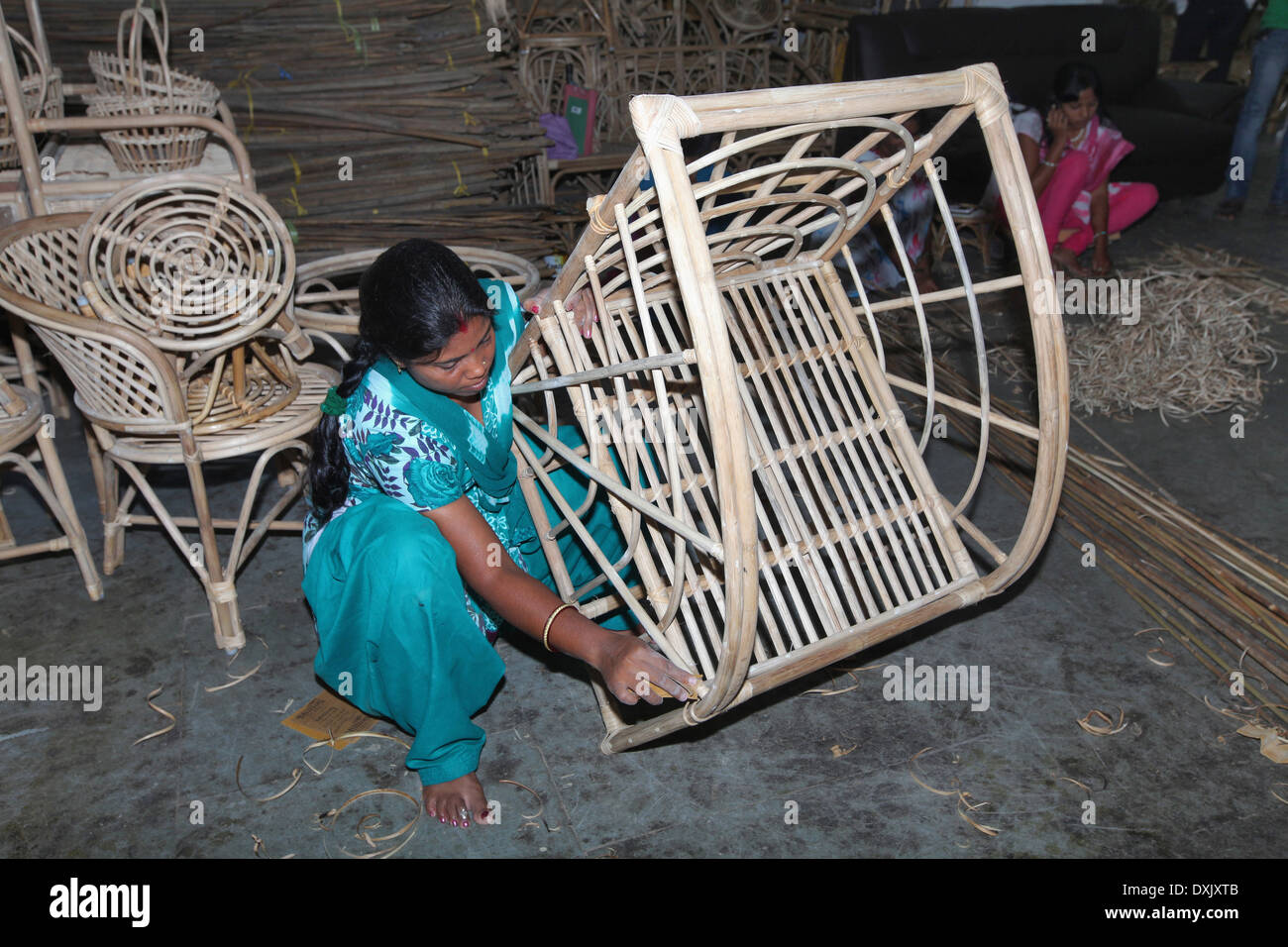 Artisan making bamboo and cane furniture items in urban village, District Hazaribaug, Jharkhand, India - Stock Image