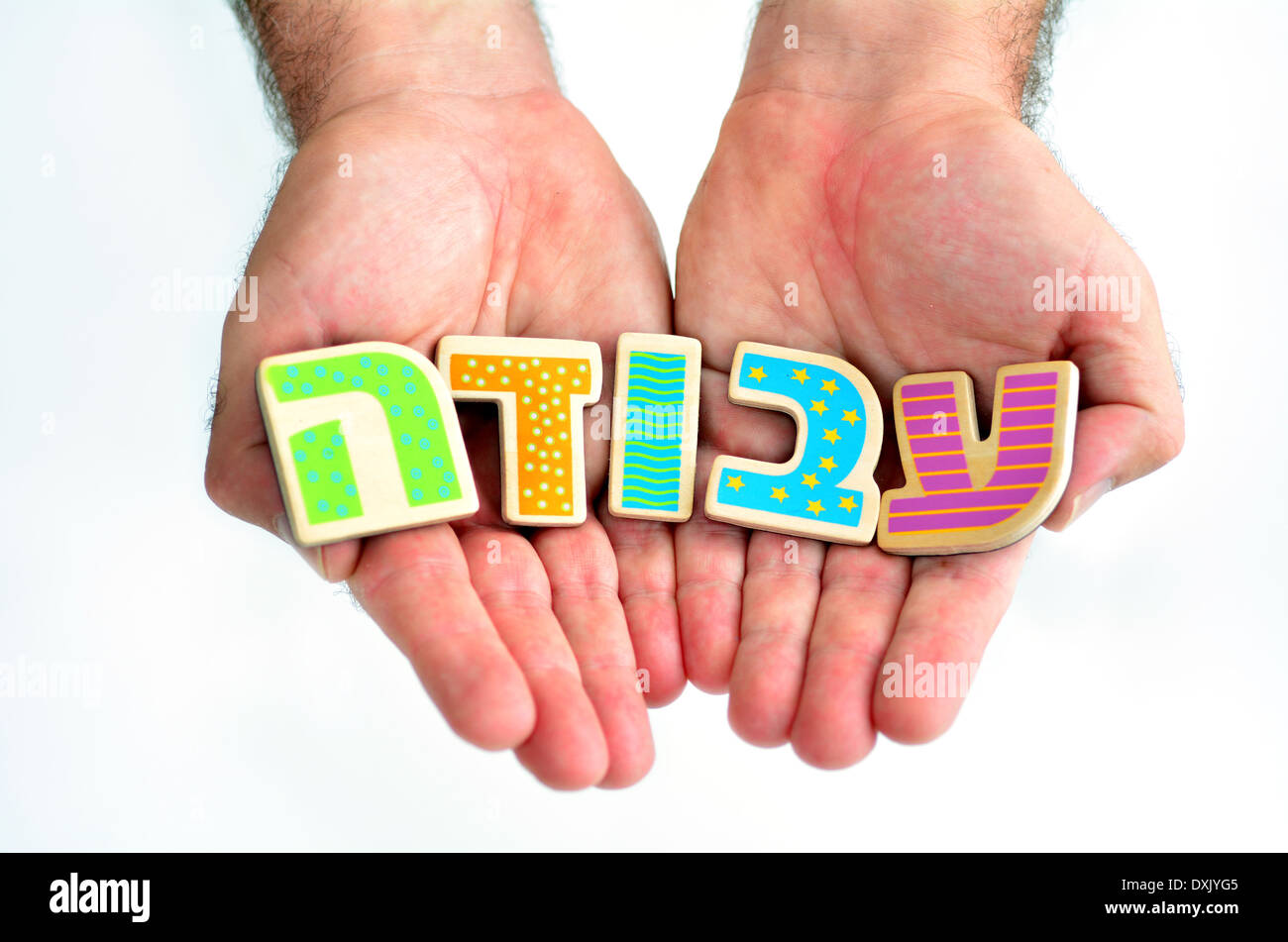 Man hands hold the word WORK in Hebrew text (Avoda) isolated on white background multi purpose concept of Job hunting. - Stock Image