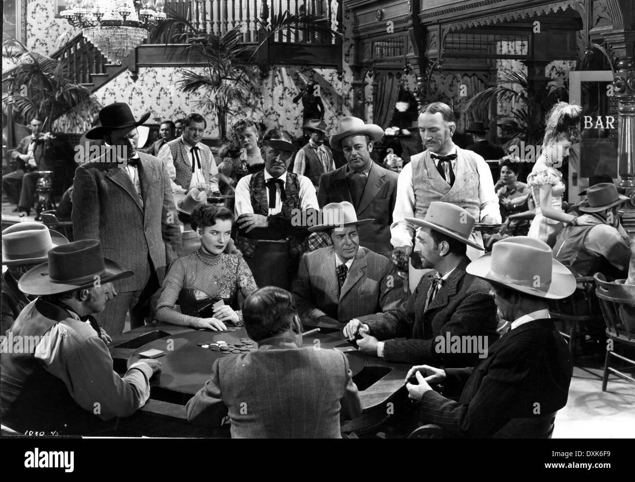 SINGING GUNS (US1950) GAMBLING POKER CARD GAME SALOON - Stock Image