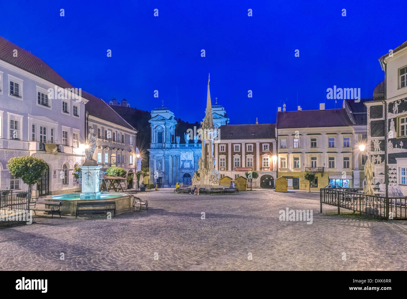 Illuminated piazza at dawn, Prague, Central Bohemia, Czech Republic - Stock Image