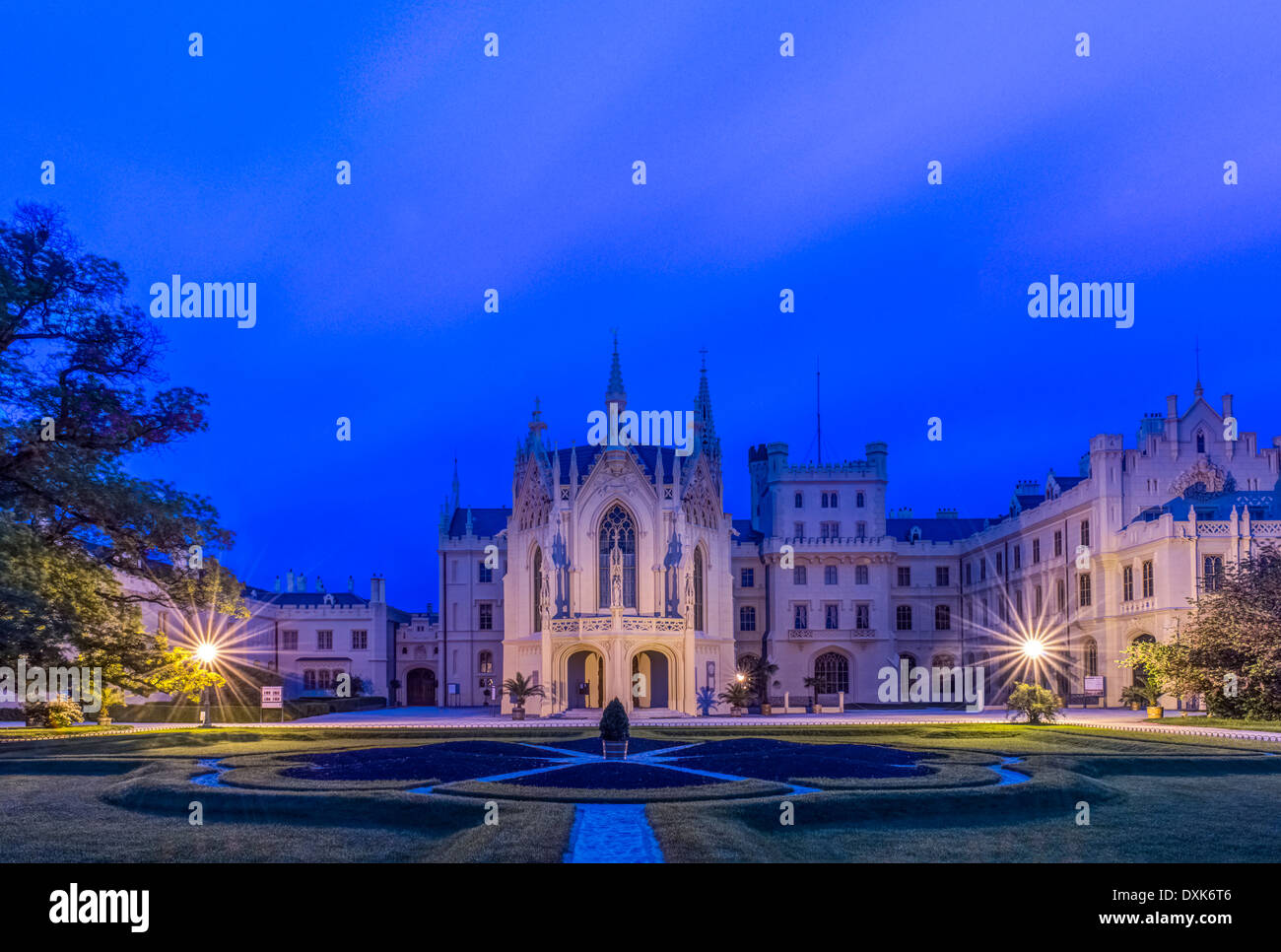 Castle illuminated at dawn, Prague, Czech Republic - Stock Image