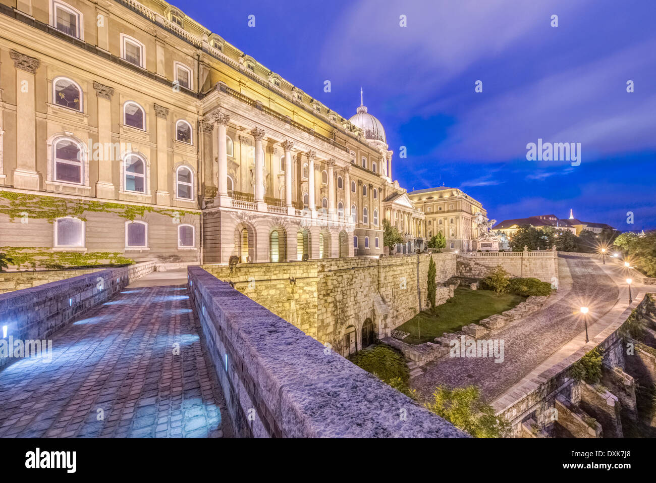 Royal Palace illuminated at dusk, Budapest, Hungary - Stock Image