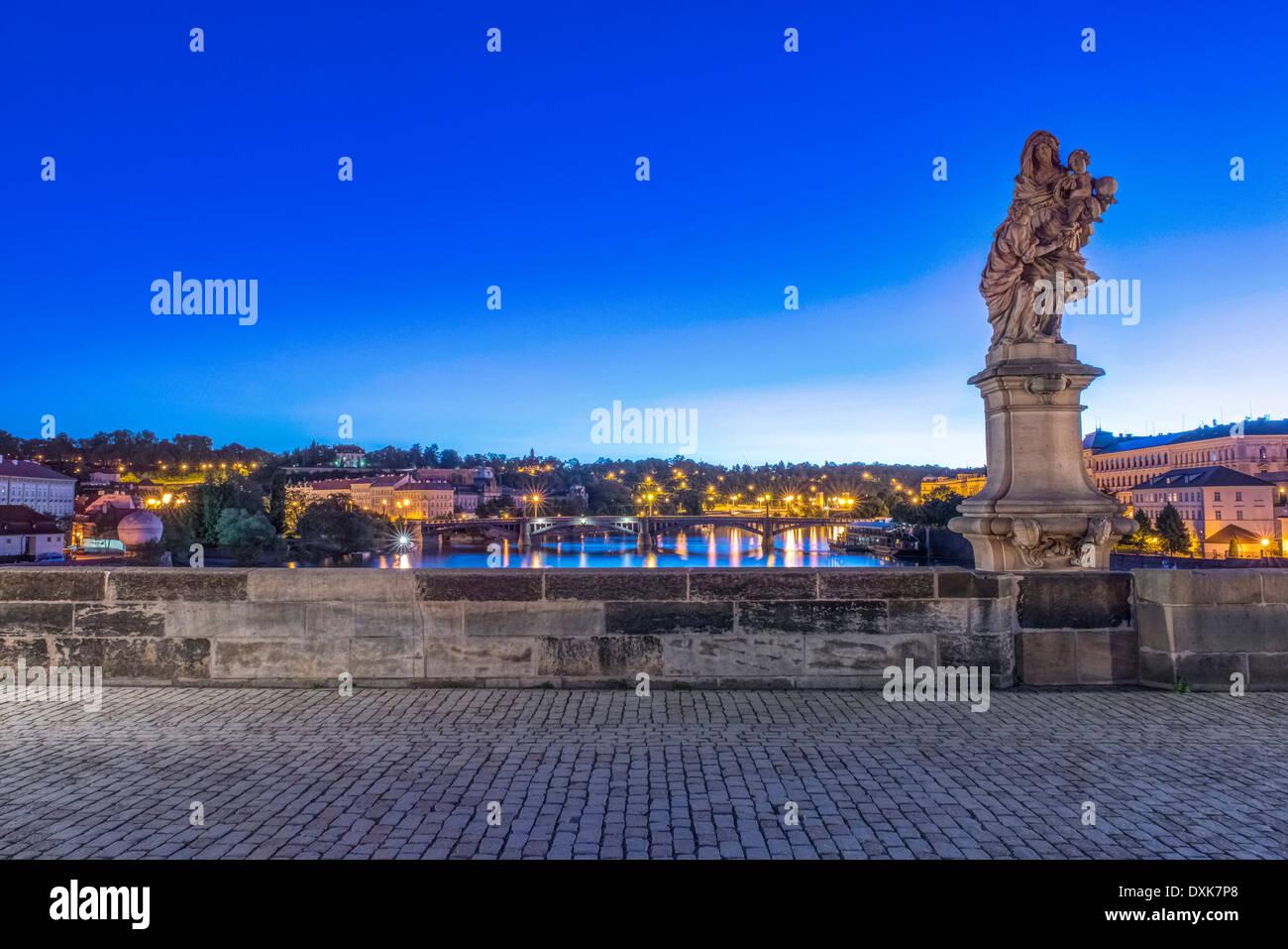 Statue and cobblestones on Charles Bridge at dawn, Prague, Czech Republic - Stock Image