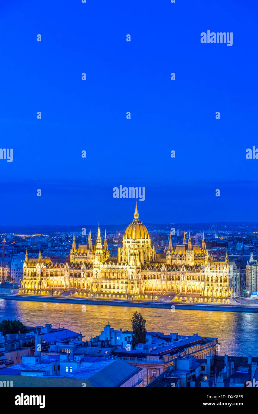 View of Parliament Building illuminated at dusk, Budapest, Hungary - Stock Image