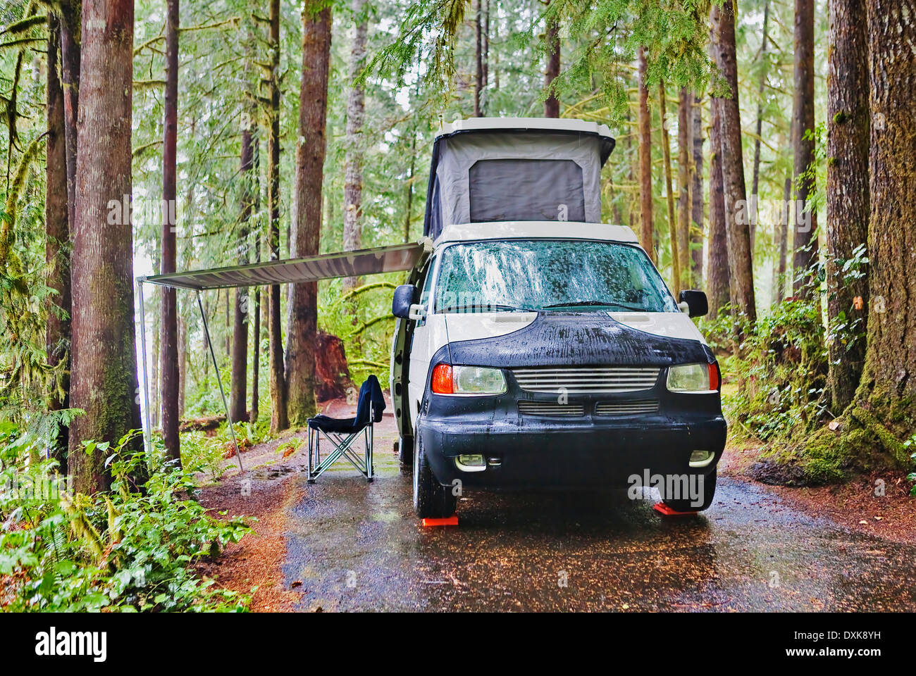 Camper van with awning parked at campsite - Stock Image