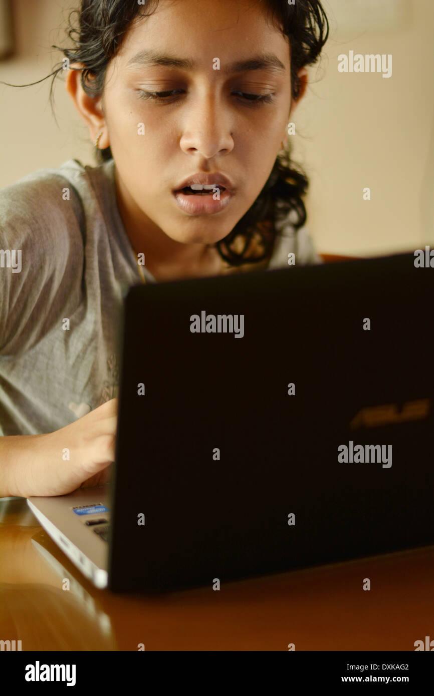 Girl using computer - Stock Image