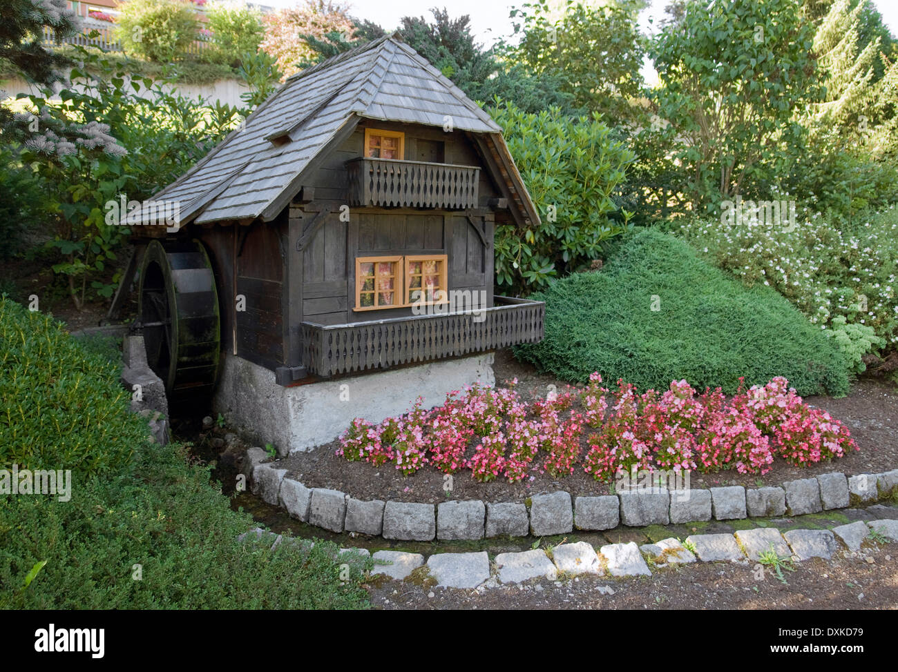 Small Decorative Watermill In A Black Forest Garden In Southern Germany At  Summer Time   Stock