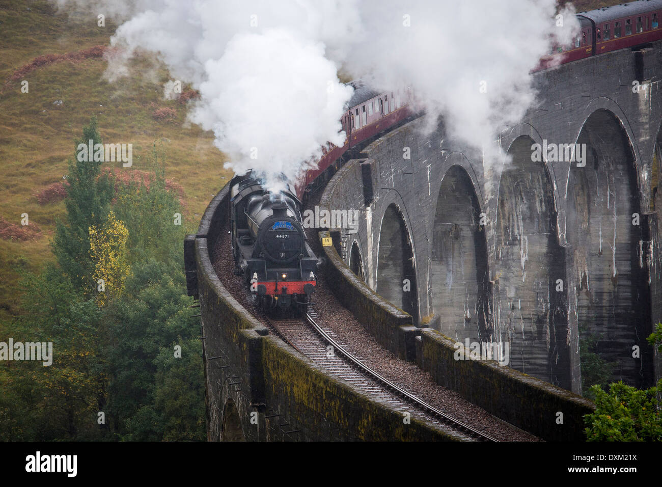 The Jacobite Steam Engine on the West Highland Line crossing the Glenfinnan Viaduct - Stock Image