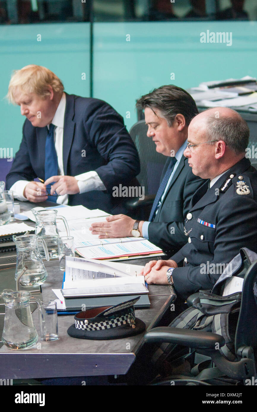 London, March 27th 2014. The Police and Crime Committee of the London Assembly questions the Mayor, his deputy for crime and policing, Stephen Greenlagh and Met Police Deputy Commissioner Craig Mackey, on undercover policing and the governance of the Metropolitan Police. Credit:  Paul Davey/Alamy Live News - Stock Image