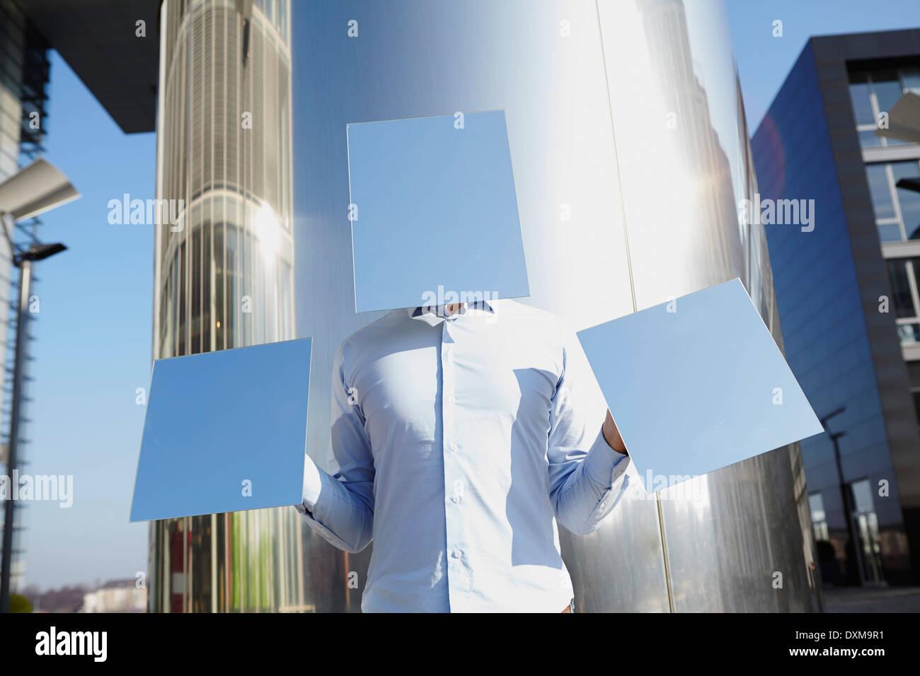 Man hidden behind light blue rectangles - Stock Image