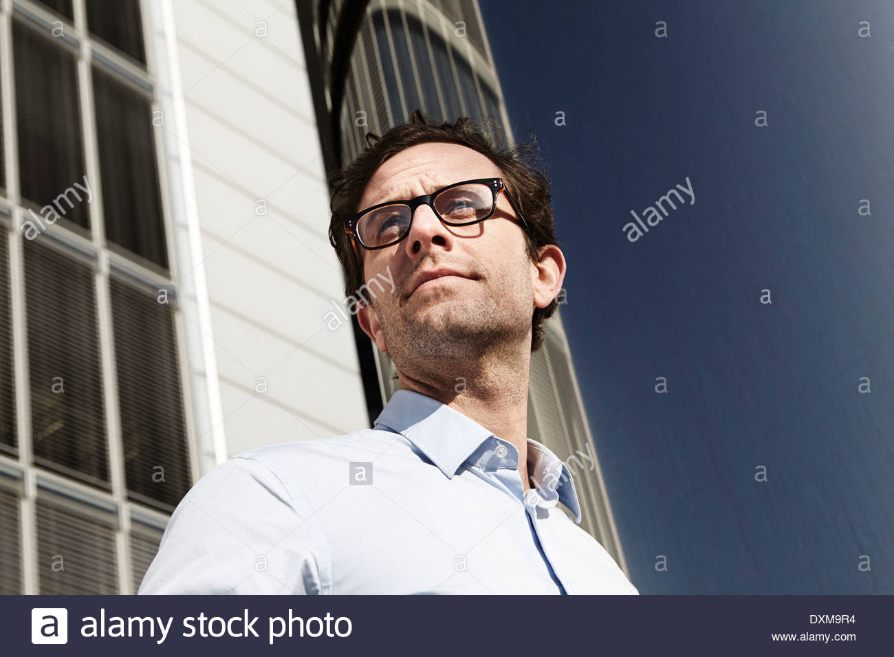 Portrait of man looking at distance - Stock Image