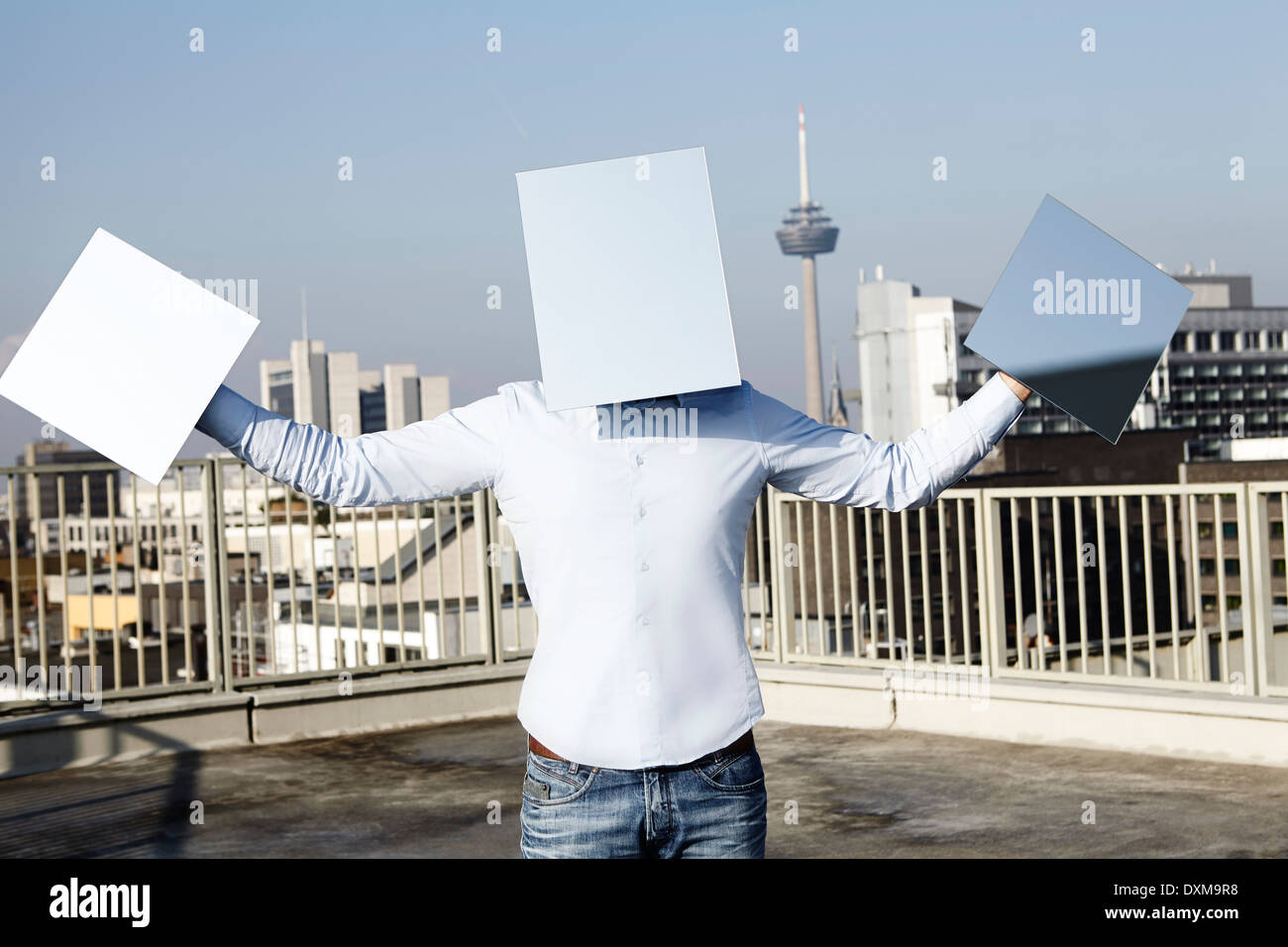 Germany, North Rhine-Westphalia , Cologne, man hidden behind light blue rectangles - Stock Image