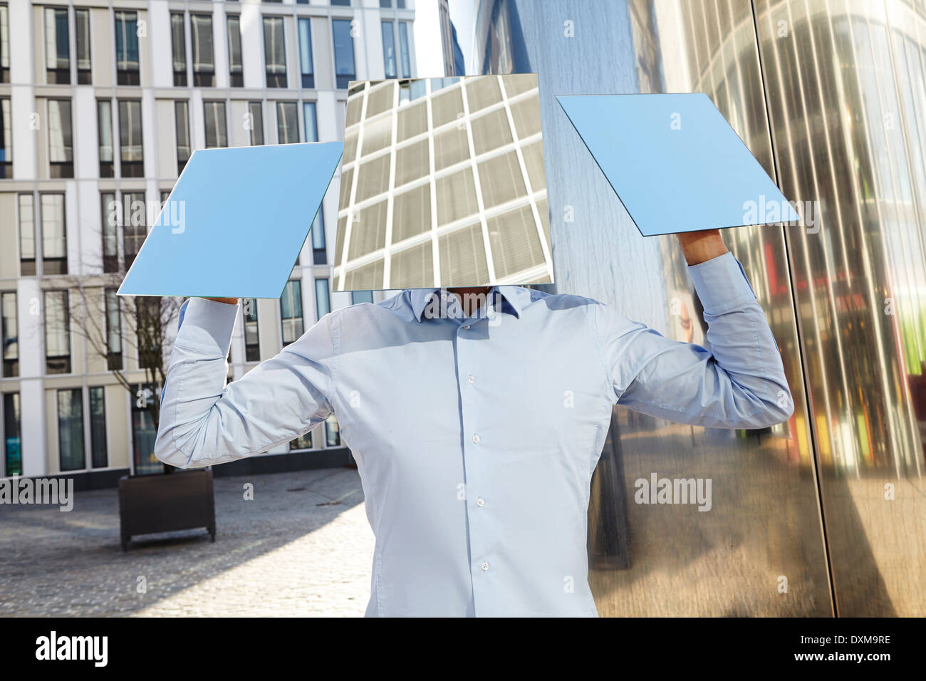 Man hidden behind rectangles - Stock Image