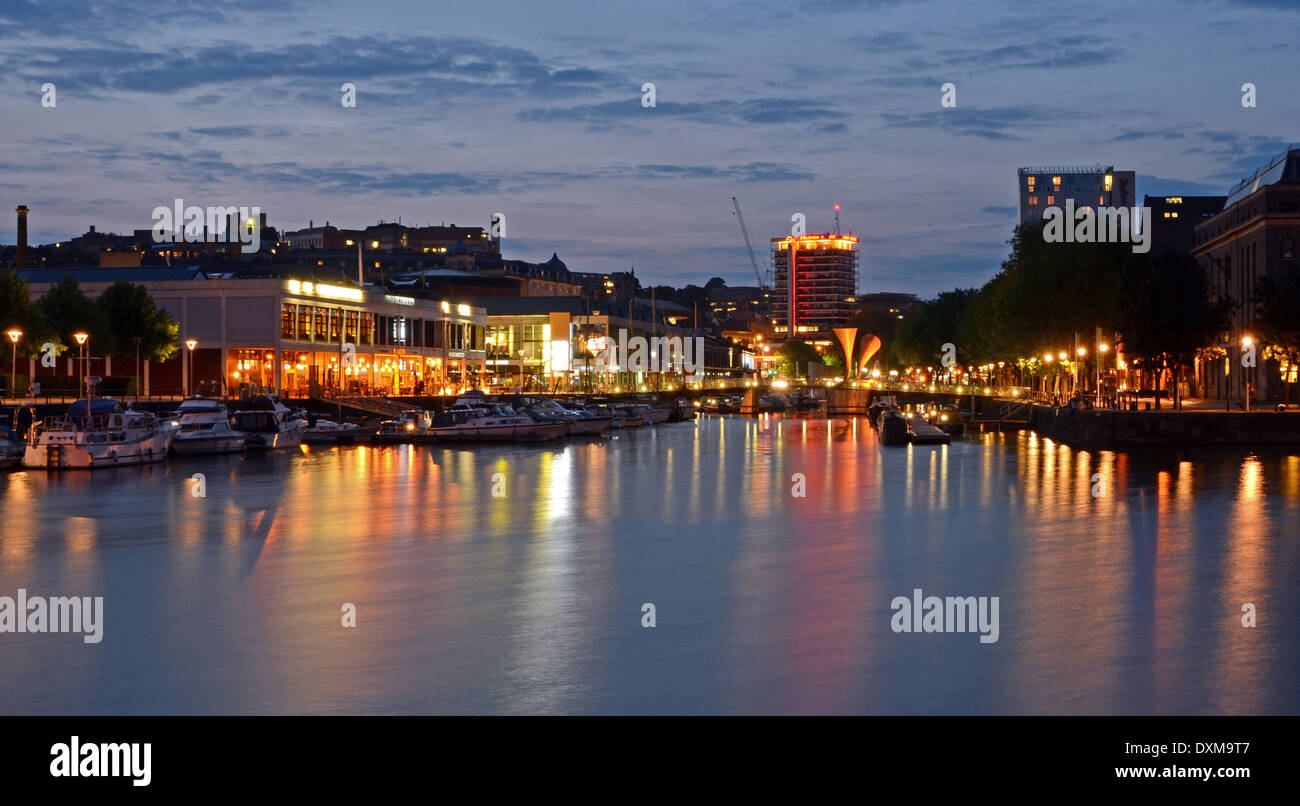 Bristol's Harbourside, illuminated at night, looking at Narrow Quay from Prince's Wharf - Stock Image