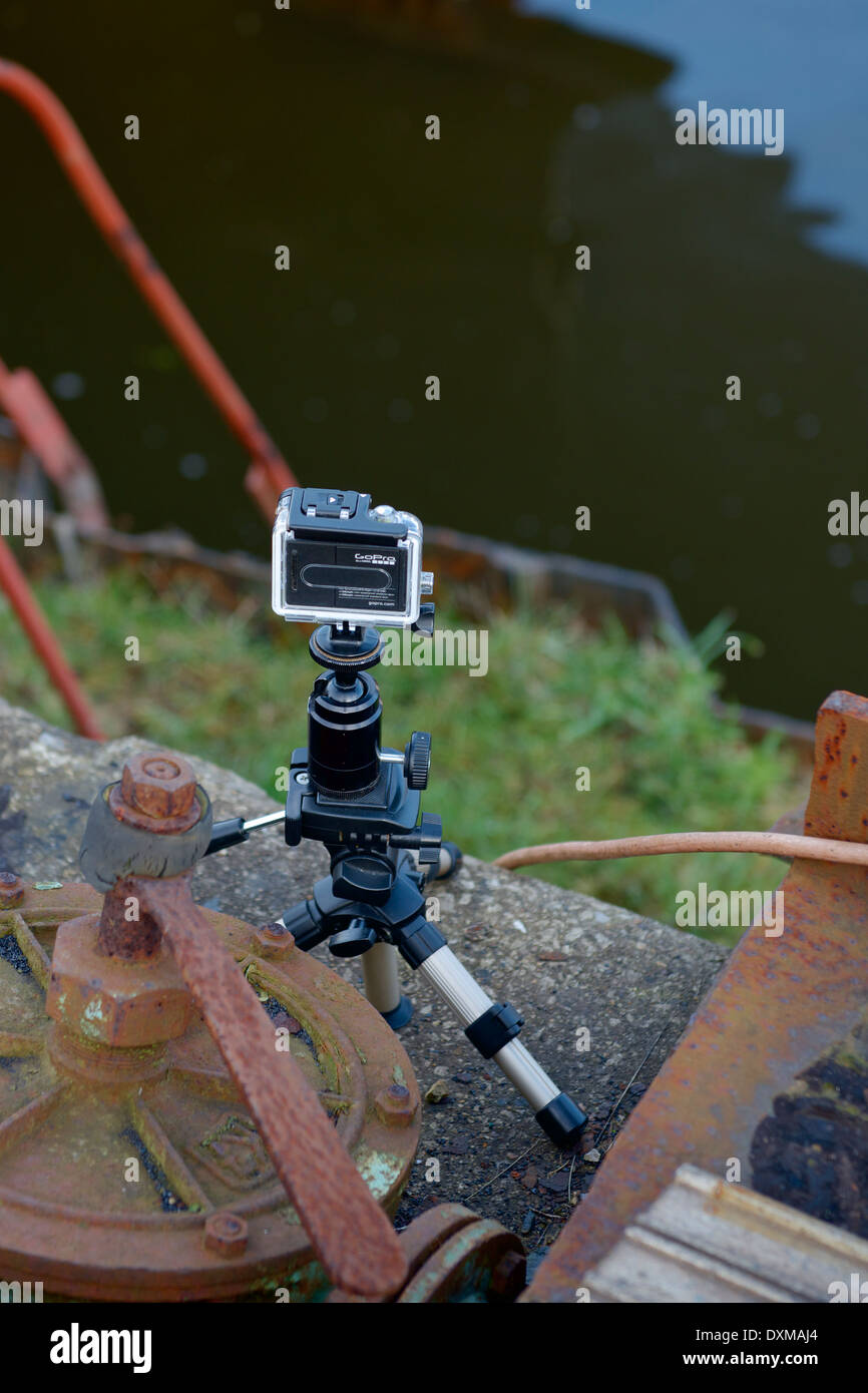 A Go Pro Hero video camera set up on a canal side to shoot some footage. New technology videography concept Stock Photo