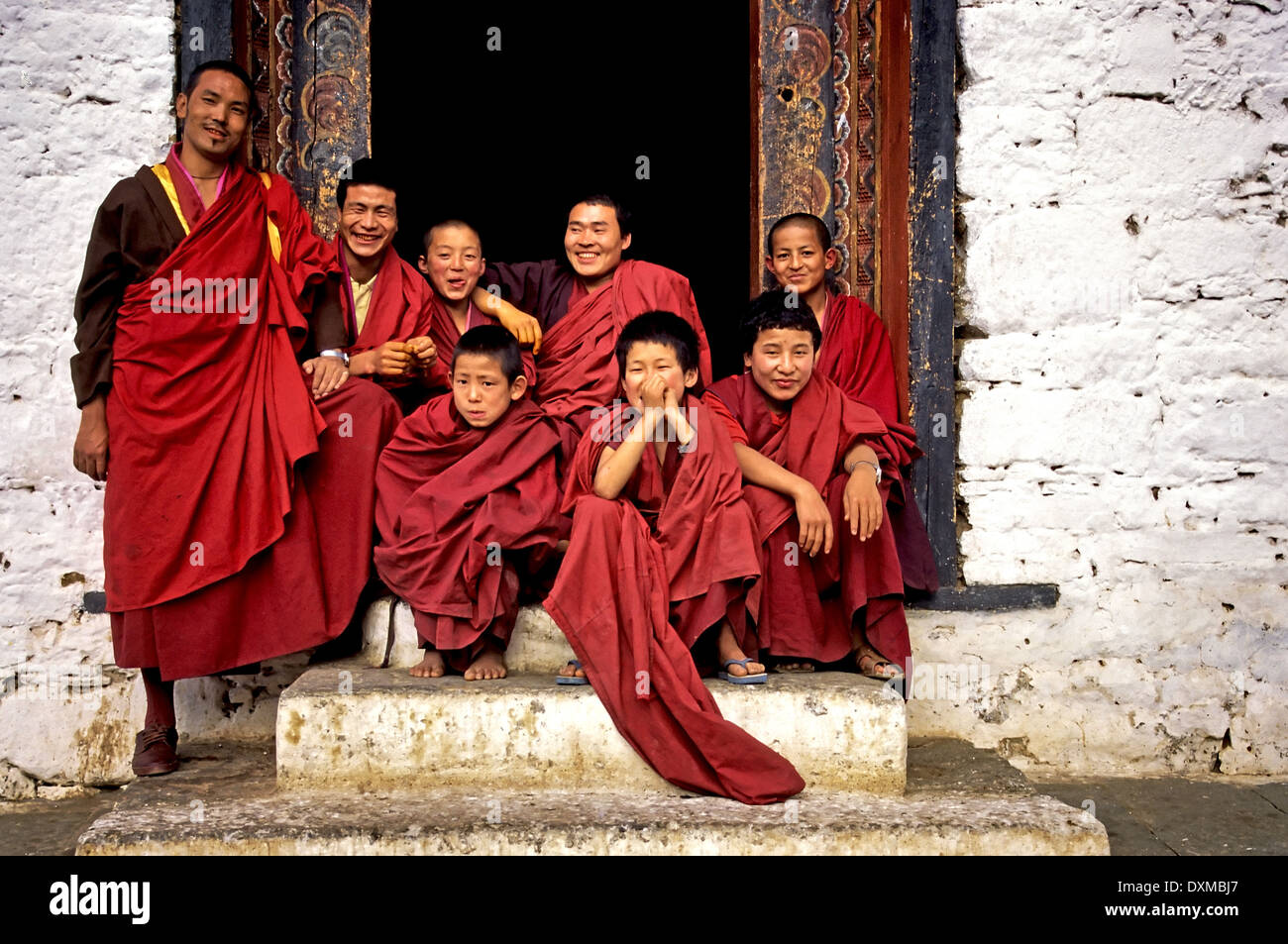 A group of monks at Thimpu Dzong, Bhutan. Digitally Manipulated Image. Stylised by sharpening and enhancing color. - Stock Image
