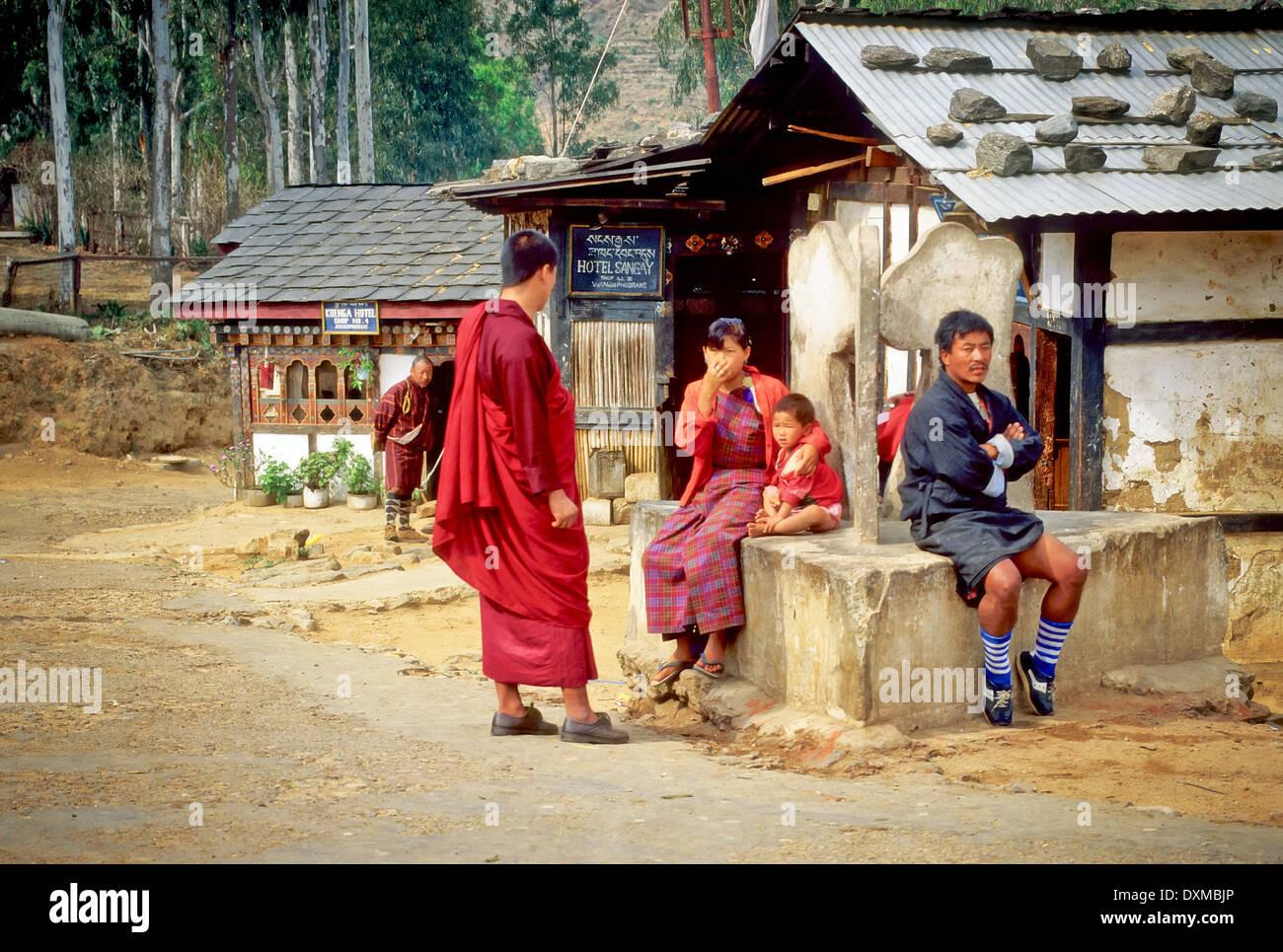Bhutanese people waiting for the bus in Wangde Phodrung. Digitally Manipulated Image. Stylised by sharpening i - Stock Image