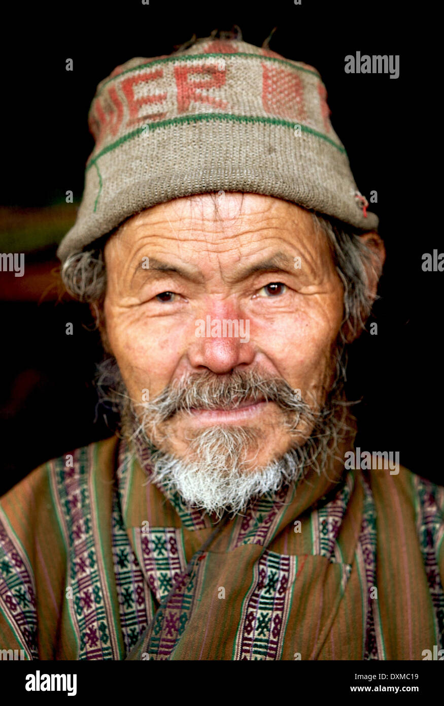Bhutanese man in woolen hat. Digitally Manipulated Image. Stylised by sharpening and enhancing color. - Stock Image