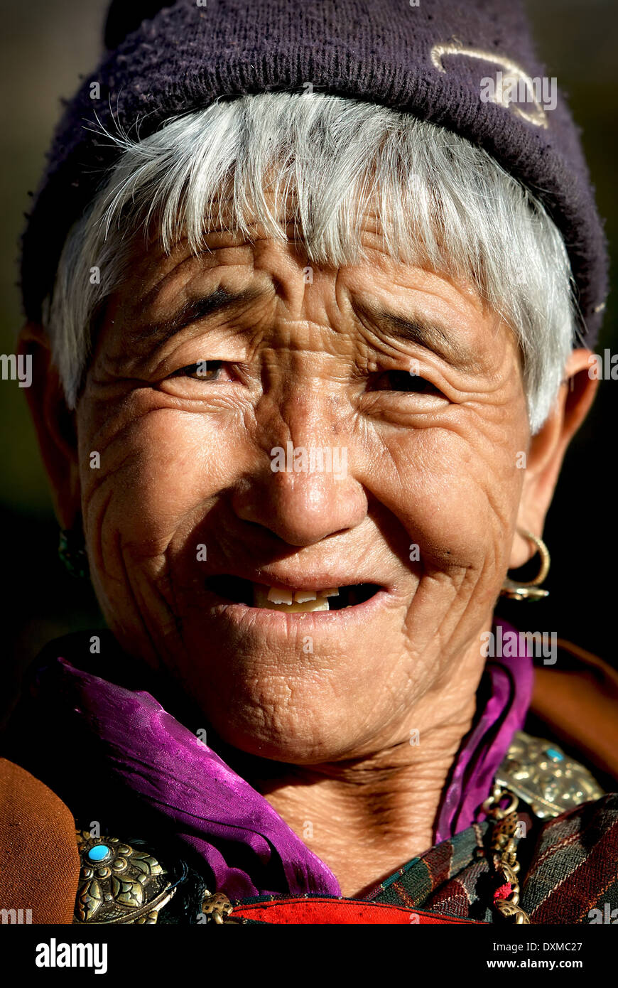 Old woman with woolen hat in Bhutan. Digitally Manipulated Image. Stylised by sharpening and enhancing color. - Stock Image