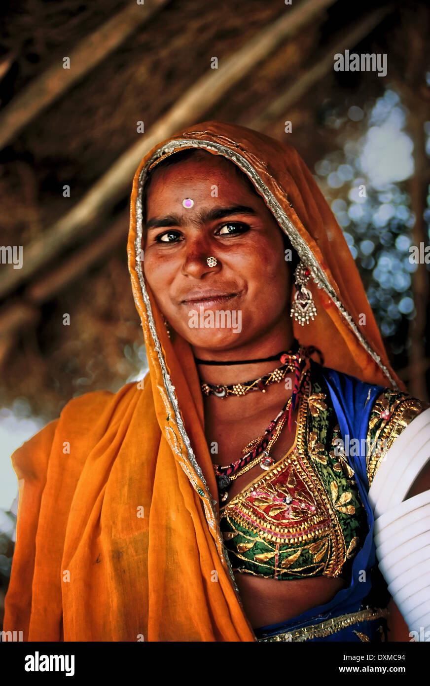 Indian woman wearing a headscarf and jewellery. In a village near Jodhpur, India. Digitally Manipulated Image. Stylised by sharp - Stock Image