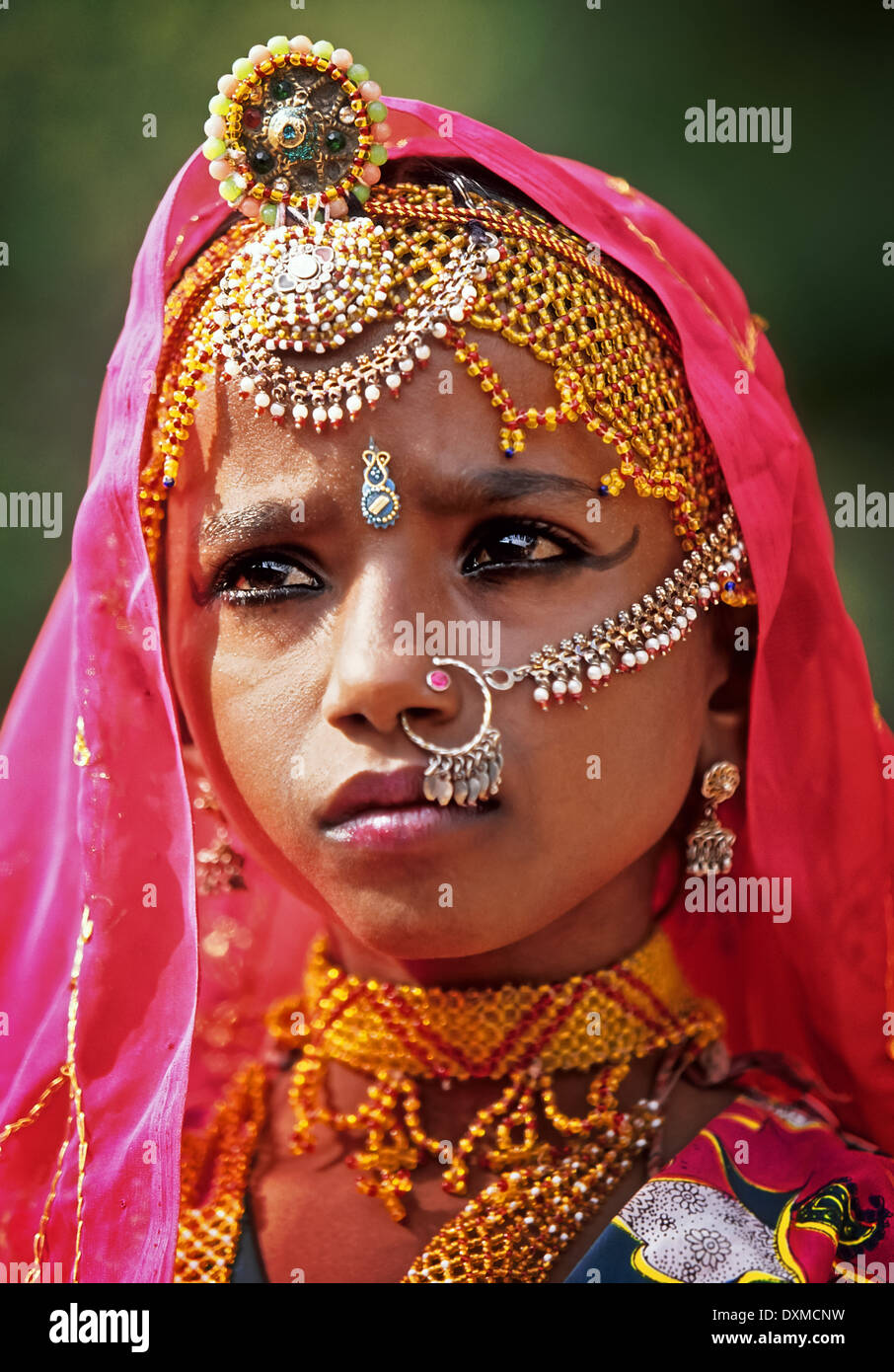 Portrait of Indian girl dancer wearing jewellery, at Mehrangarh Fort in Jodhpur, India. Digitally Manipulated Image - Stock Image