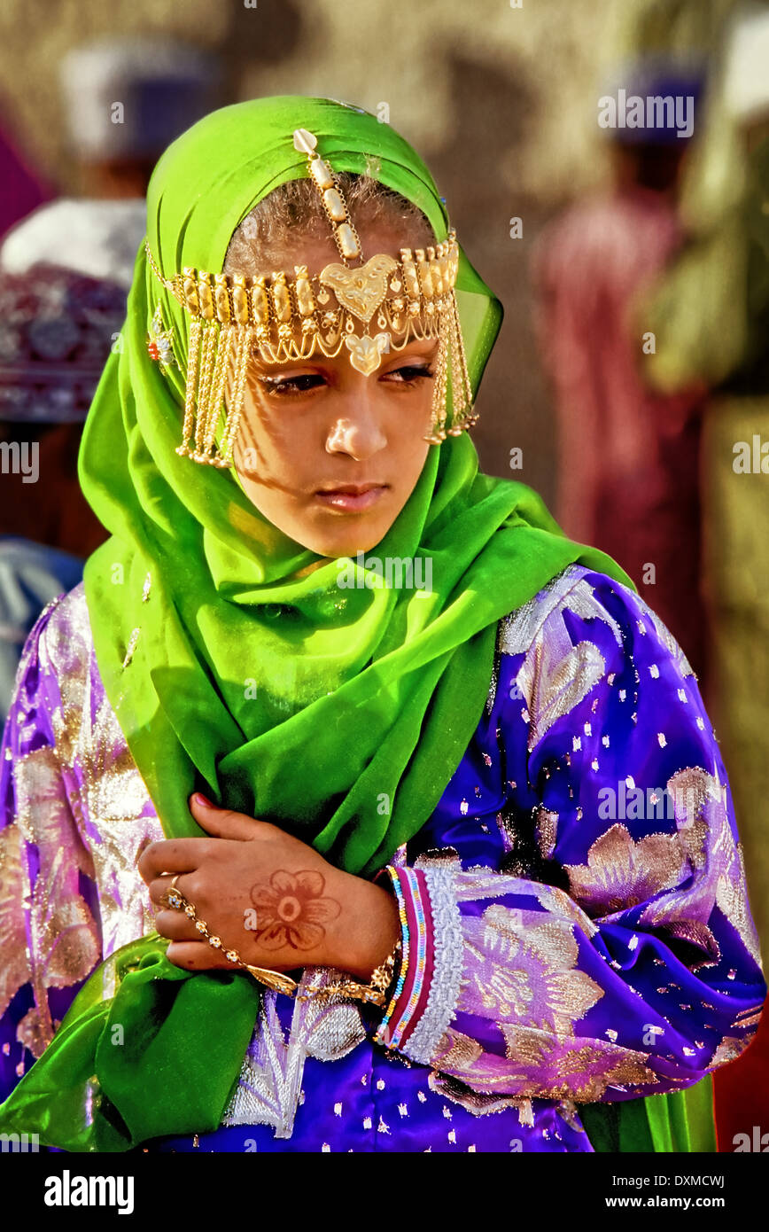 Girl with gold jewellery at the Eid al-Fitr celebrations in Fanja, Oman. Digitally Manipulated Image. Stylised by sharpening and - Stock Image
