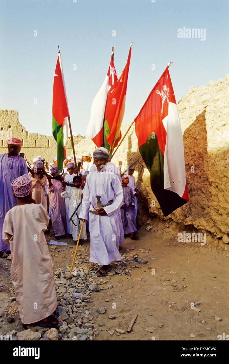 Download Oman Eid Al-Fitr 2018 - omani-men-in-procession-with-omani-flags-at-the-eid-al-fitr-celebrations-DXMCWX  2018_18563 .jpg