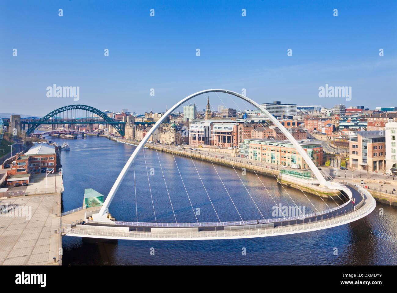 gateshead Millennium bridge and Tyne bridge over River Tyne Newcastle upon Tyne skyline Tyne and Wear England UK Stock Photo