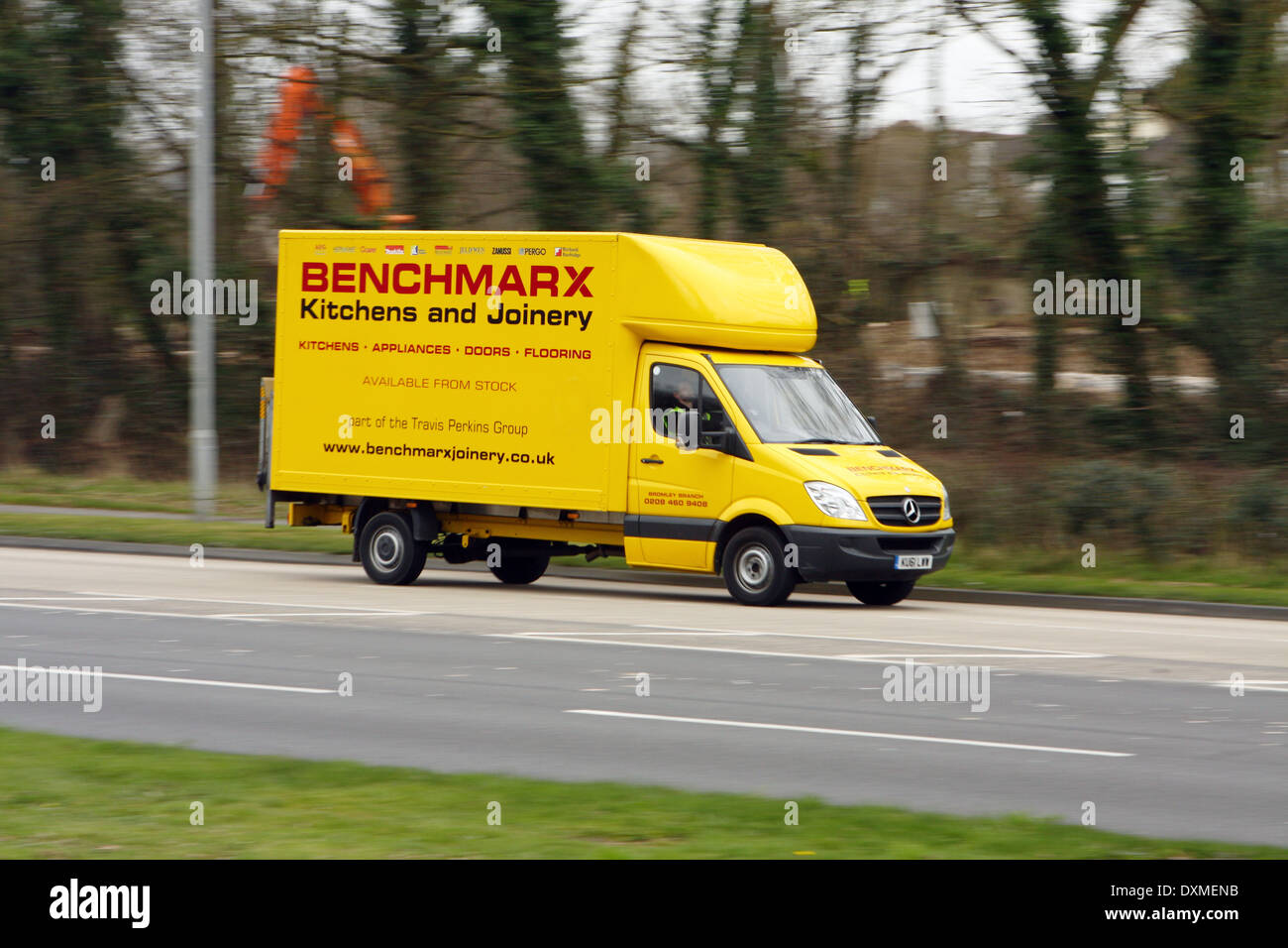 A Benchmarx truck traveling along the A23 road in Coulsdon Surrey England & A Benchmarx truck traveling along the A23 road in Coulsdon Surrey ...