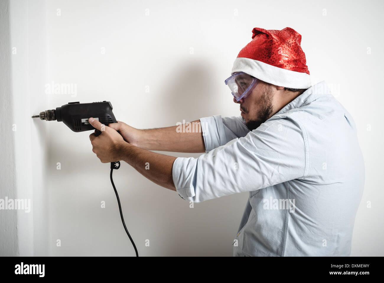 bricolage christmas stylish young man on white background - Stock Image