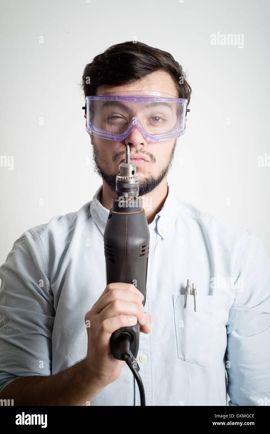 young man bricolage working at home - Stock Image