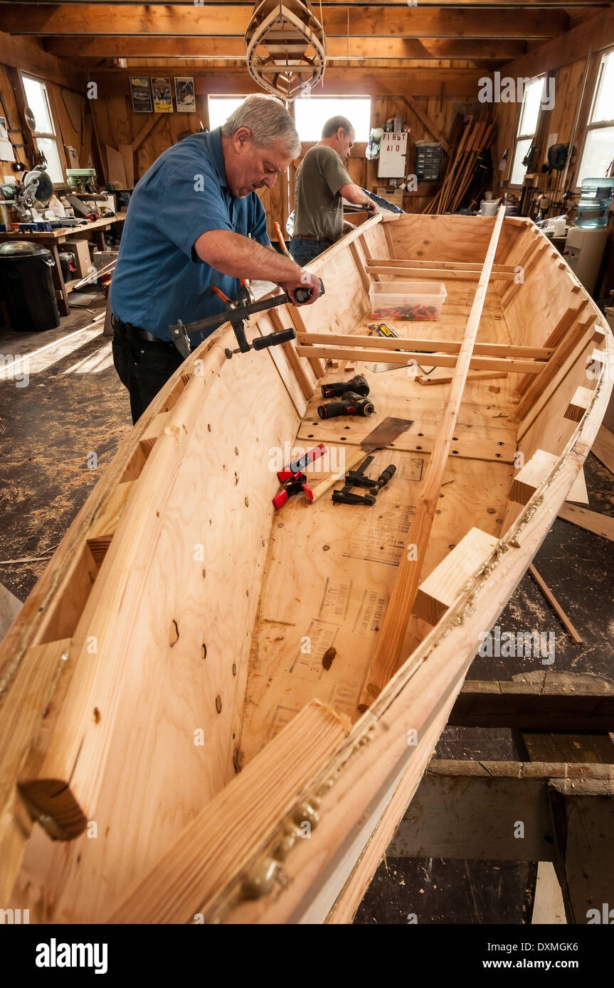 Building a wooden boat at the Port of Toledo Community Boathouse; Toledo, Oregon. Stock Photo